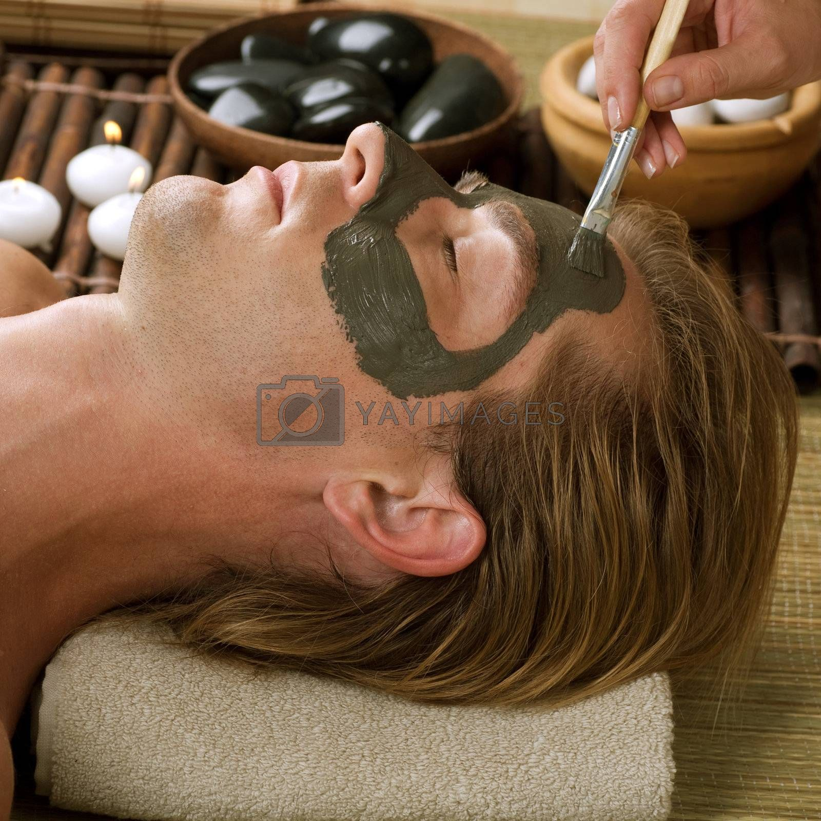 Spa. Handsome Man With A Mud Mask On His Face
