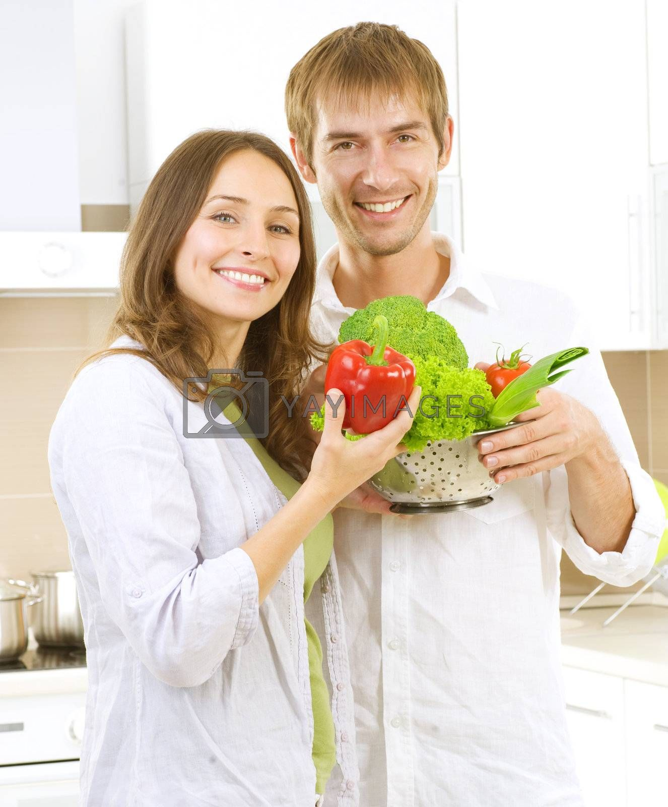 Young Couple Cooking Healthy food.Diet.Kitchen by Subbotina Anna