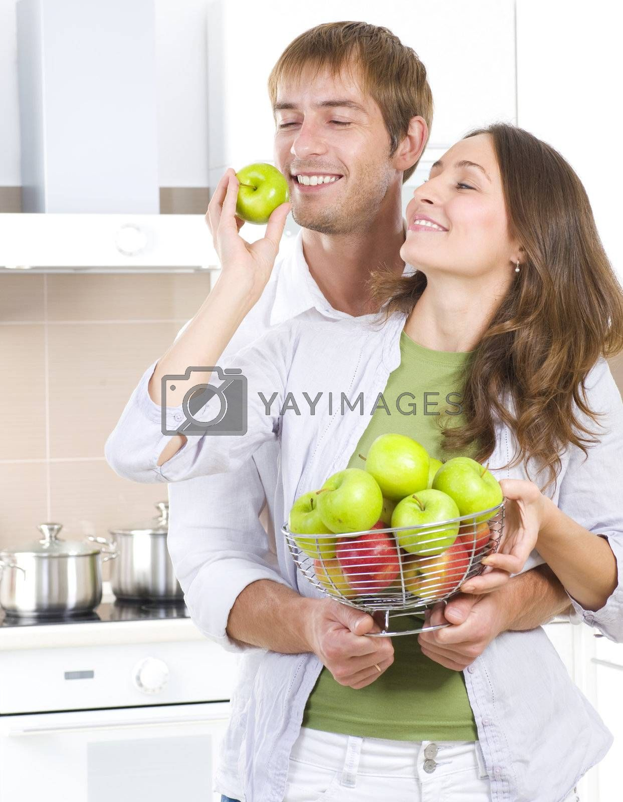 Lovely Sweet Couple eating fresh fruits.Healthy food.Diet by Subbotina Anna
