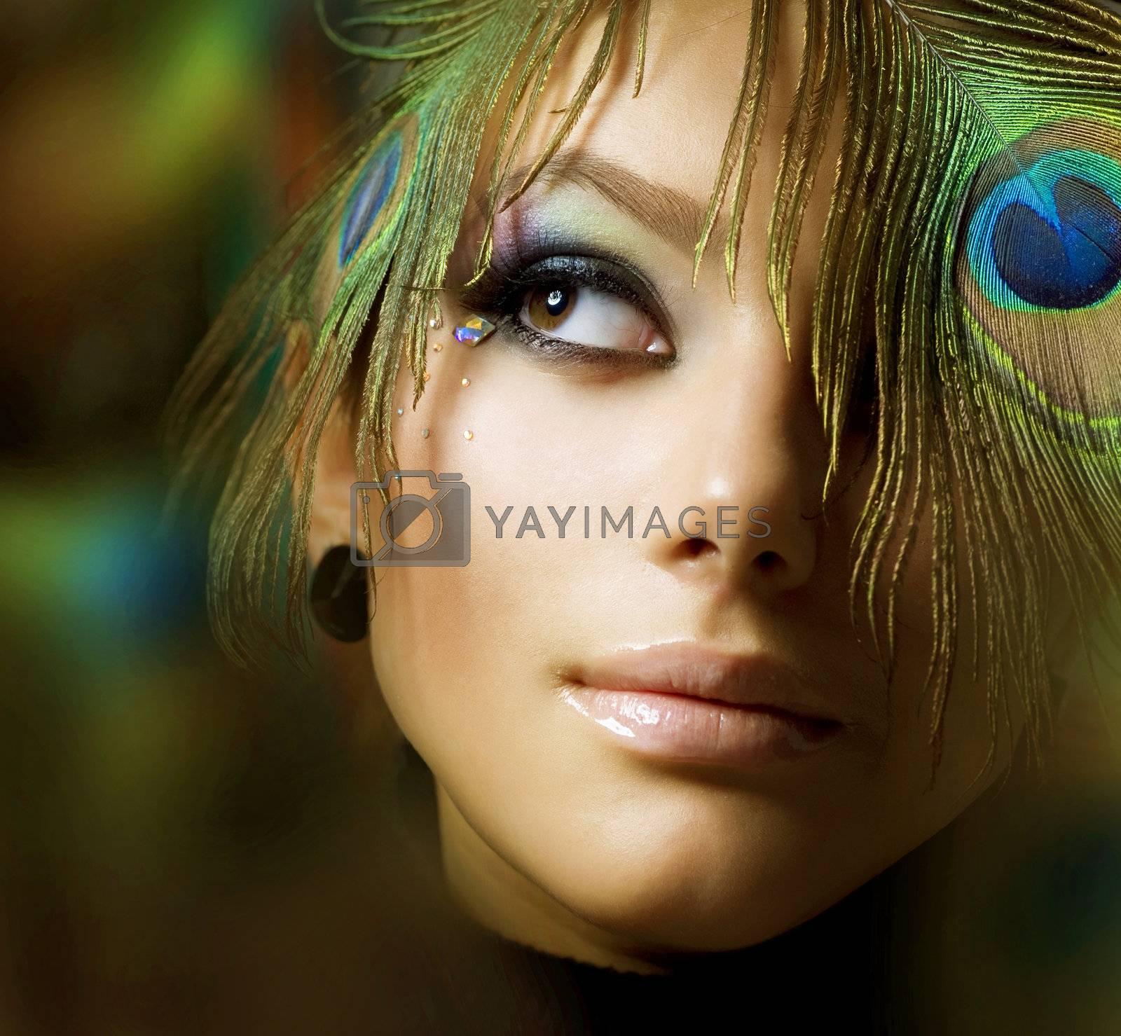 Beautiful Fashion Girl face. Peacock Makeup