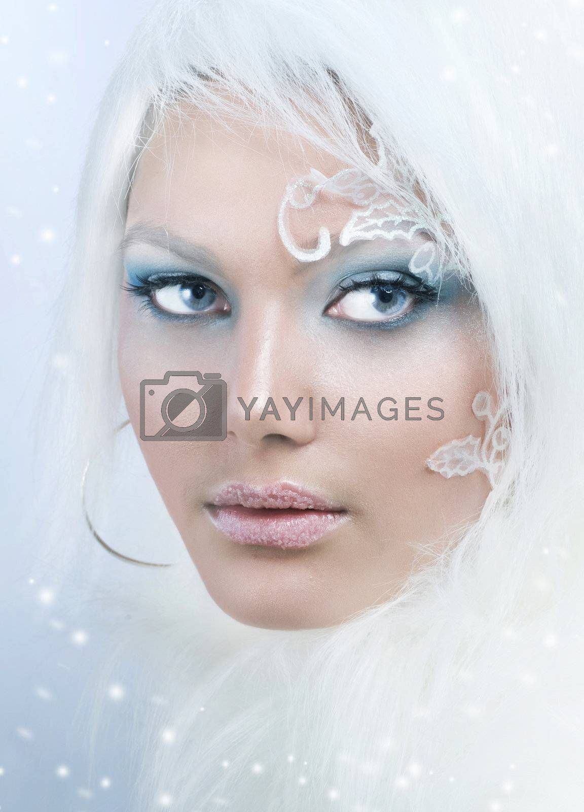 Beautiful Girl's Face. Creative Winter Makeup