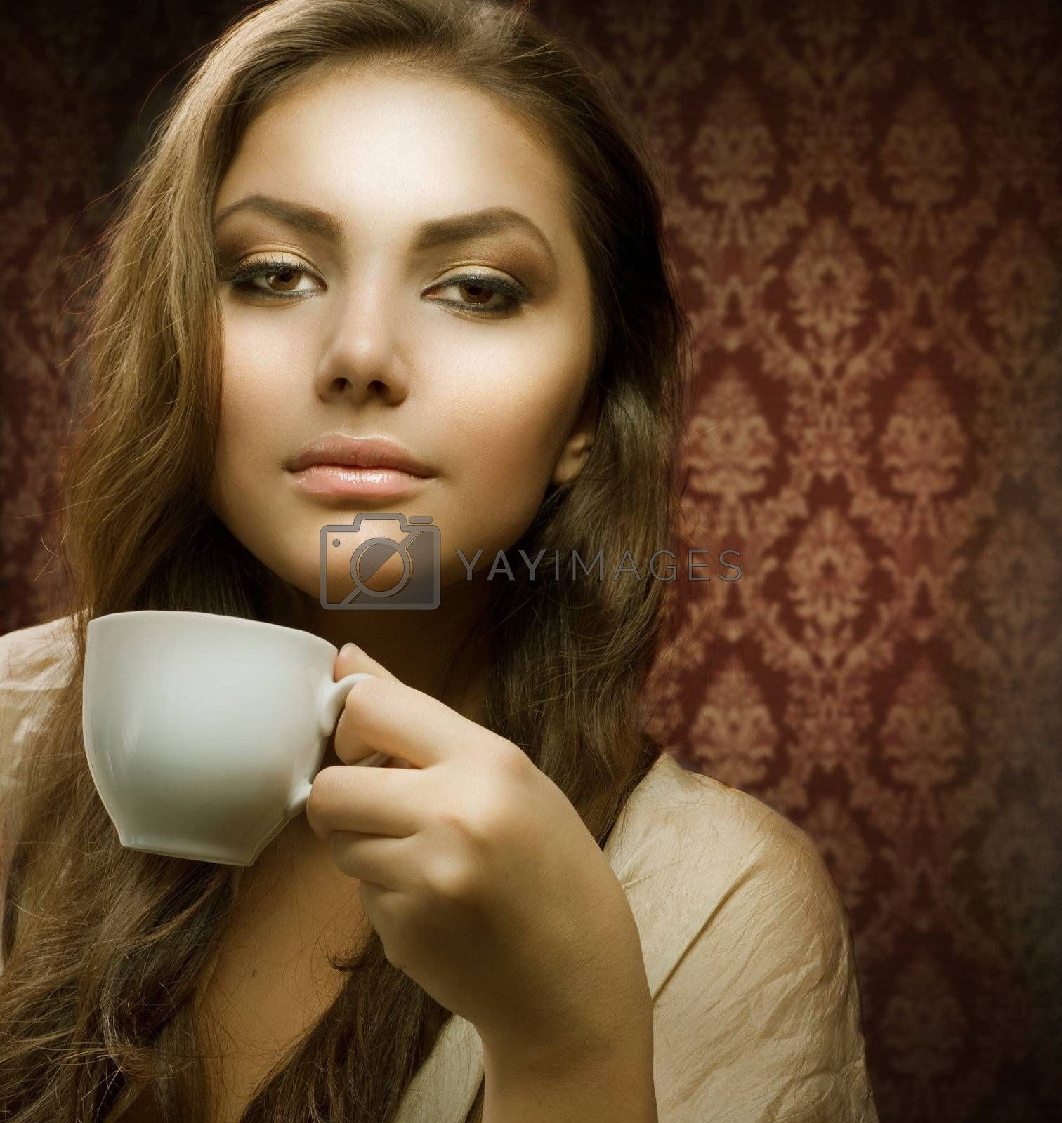 Royalty free image of Beautiful Woman with cup of coffee by SubbotinaA