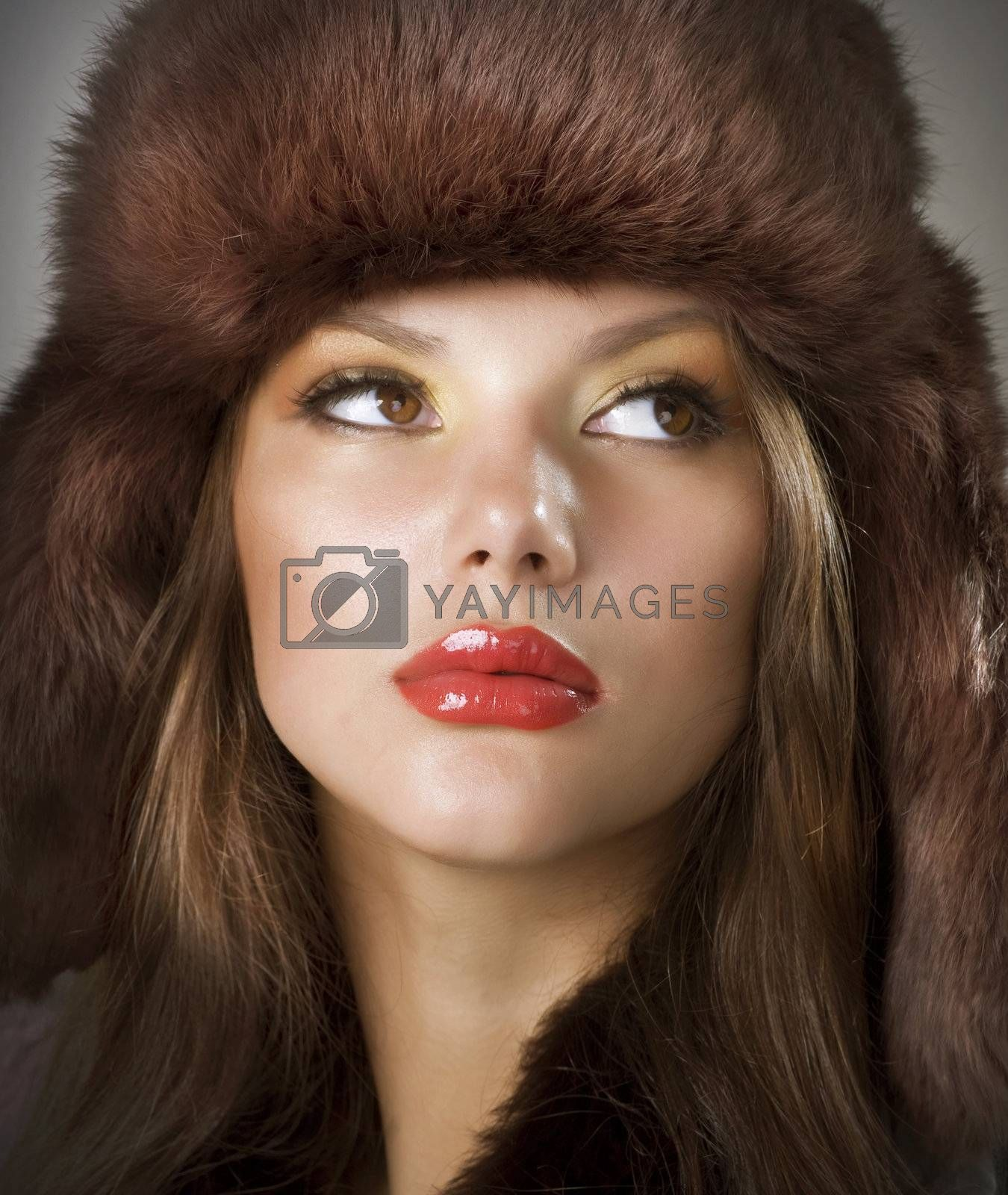 Beautiful Young Woman wearing Fur Hat.Winter Style