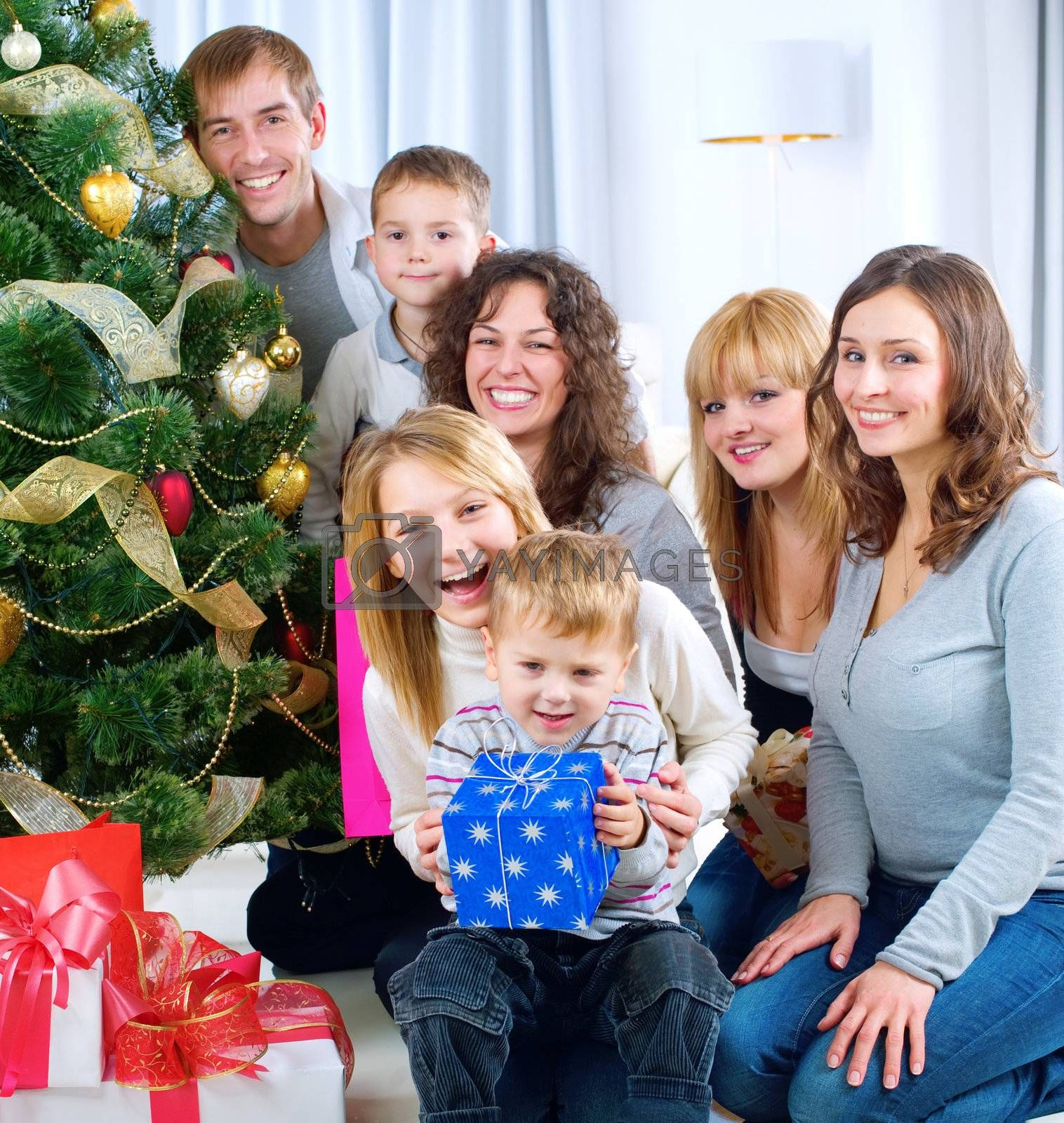 Happy Big family holding Christmas presents at home.Christmas tr by Subbotina Anna