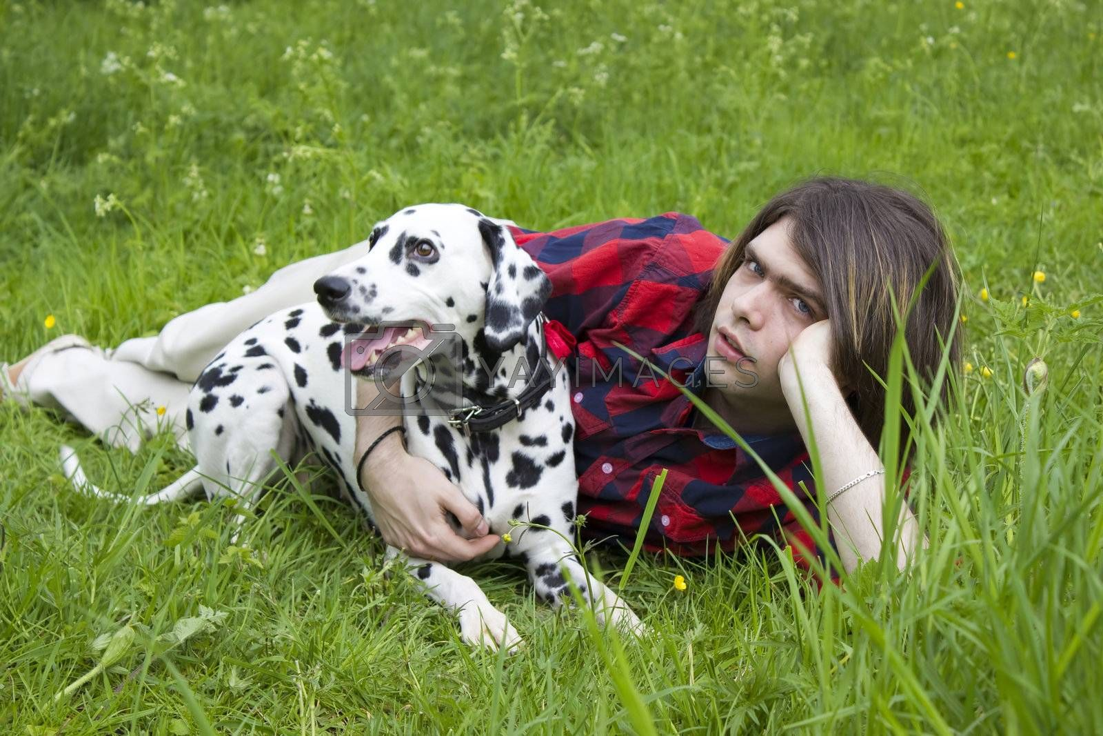 boy and the dalmatian dog on the grass