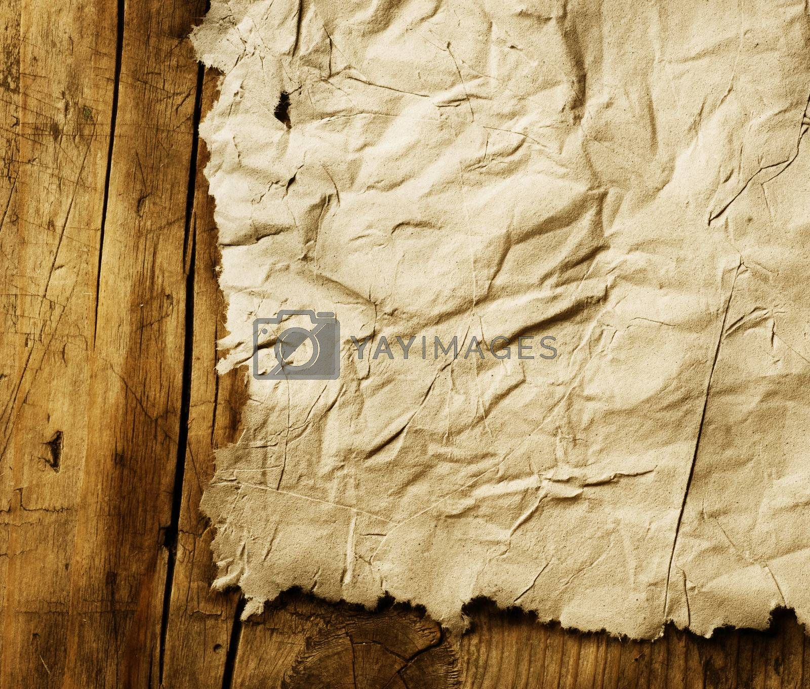 Old Paper sheet over wooden background closeup by Subbotina Anna