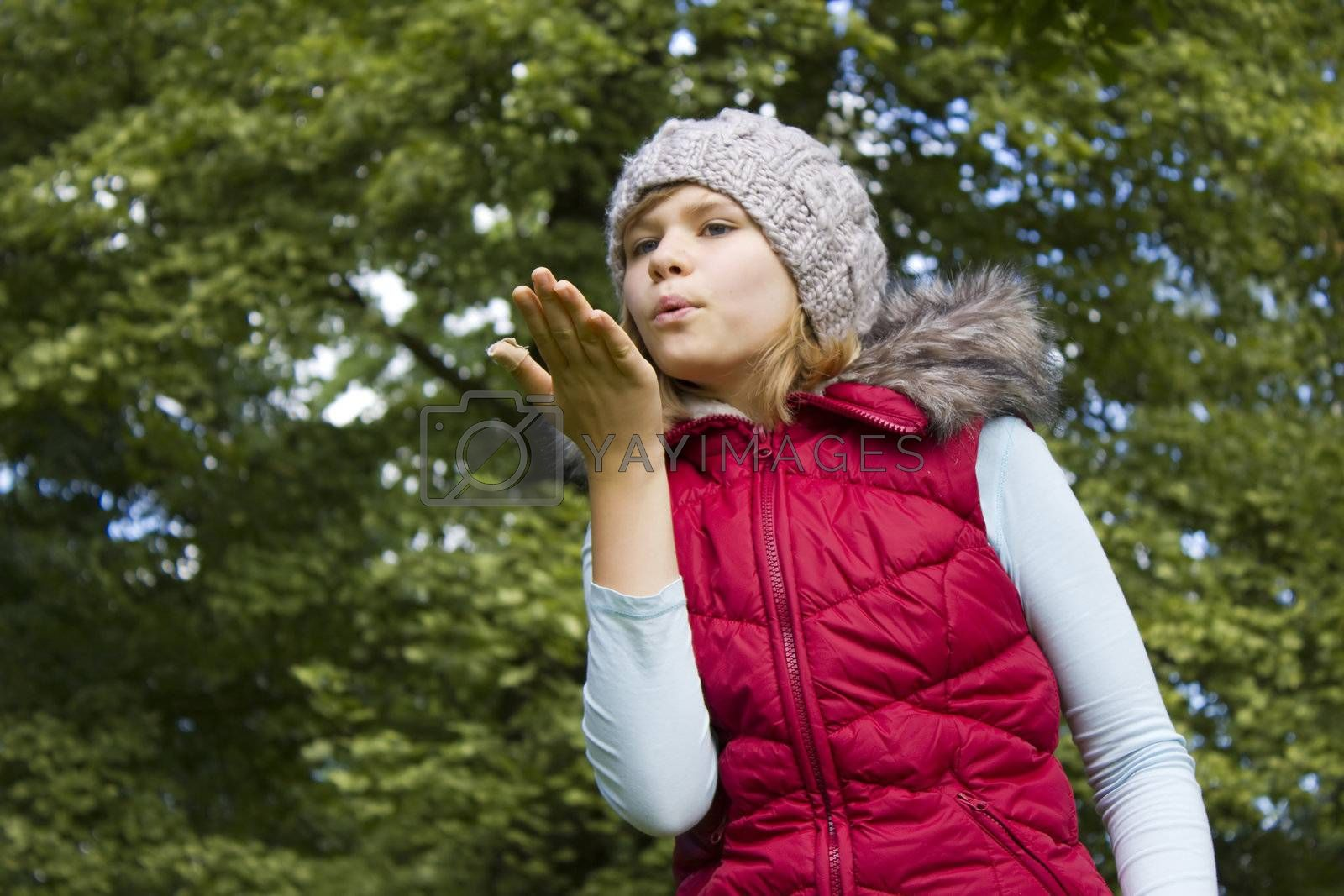 young girl blowing wind with lips