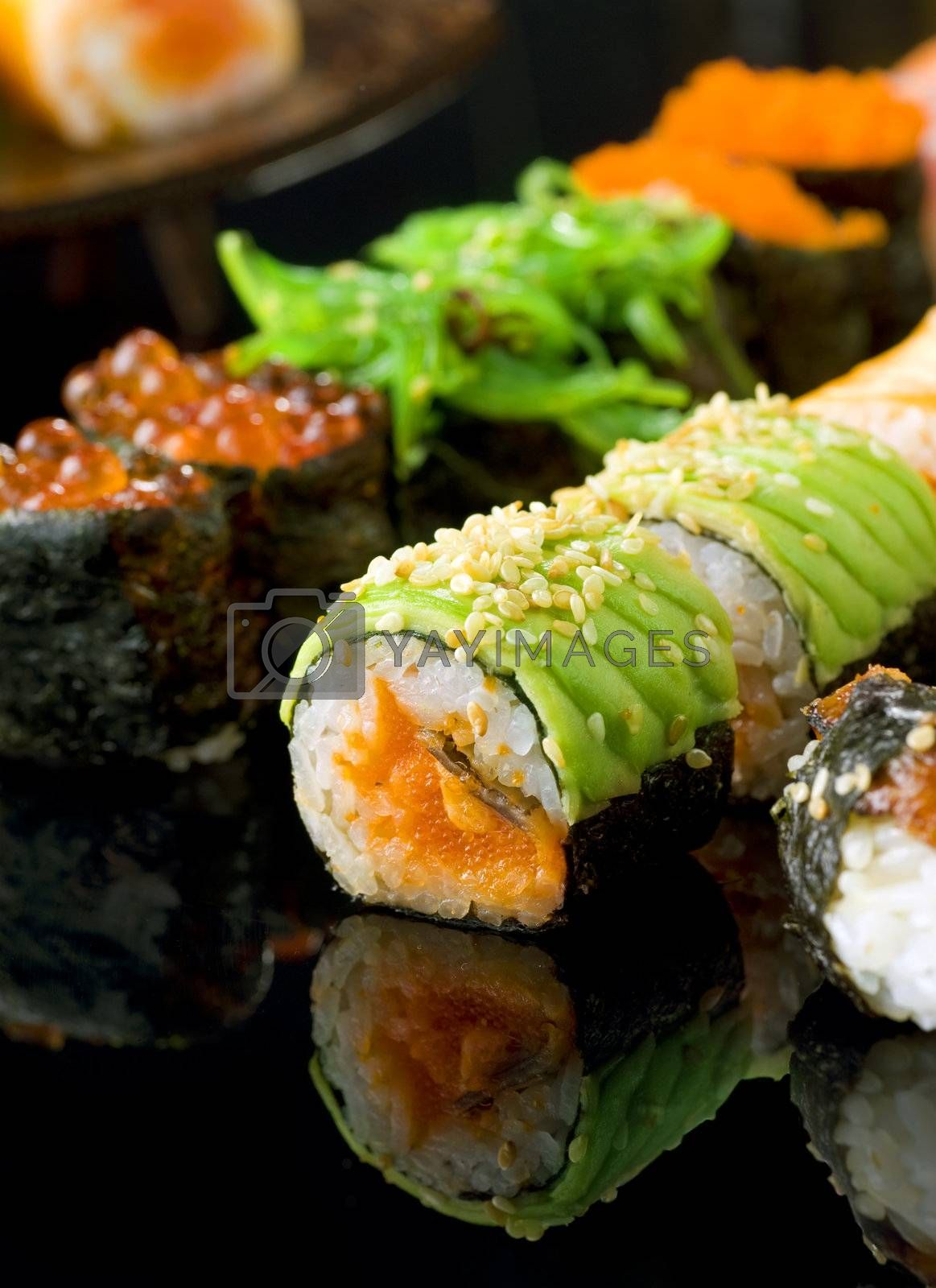 Sushi and Rolls closeup by Subbotina Anna