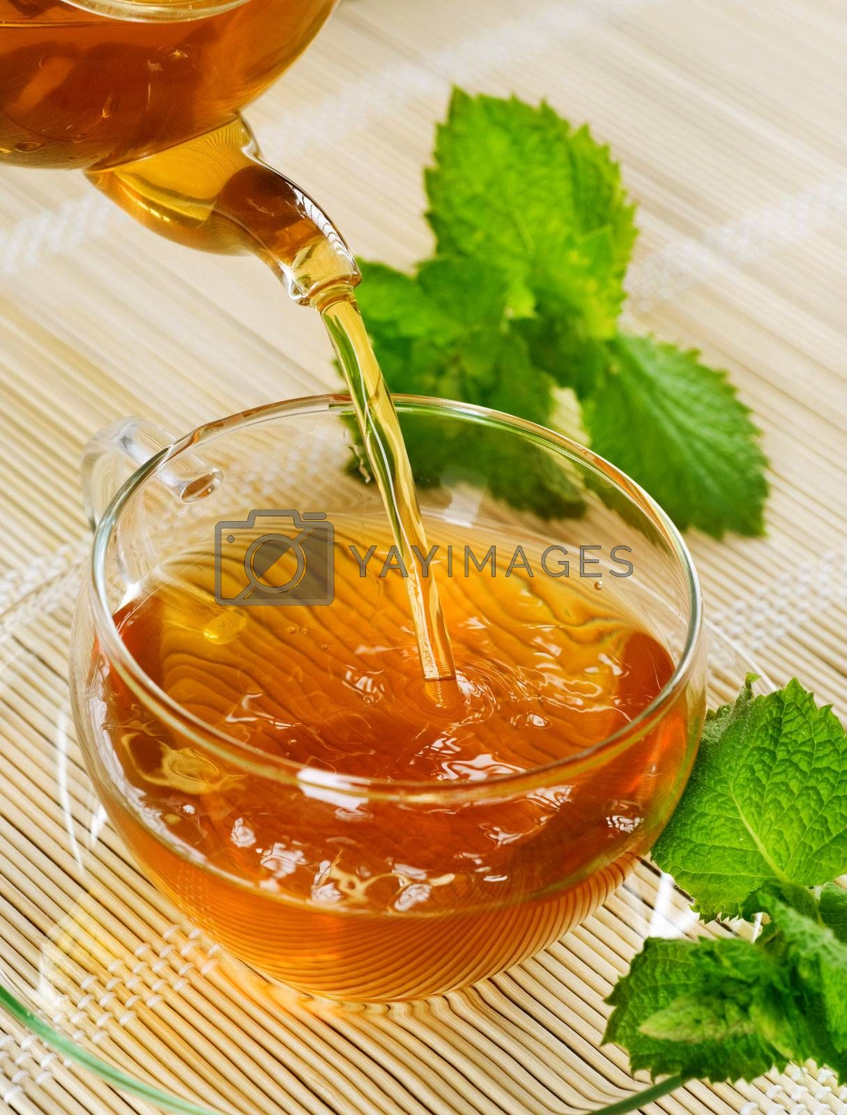 Pouring Healthy Tea With Mint by Subbotina Anna