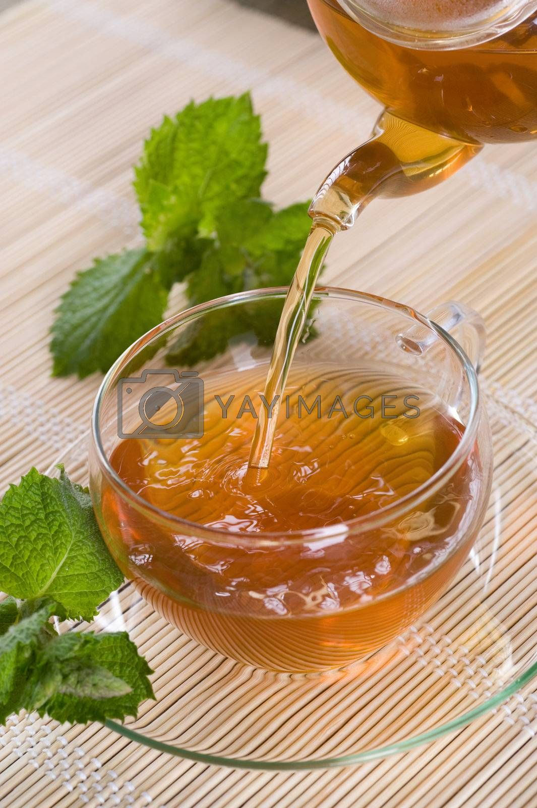 Pouring Healthy Tea by Subbotina Anna