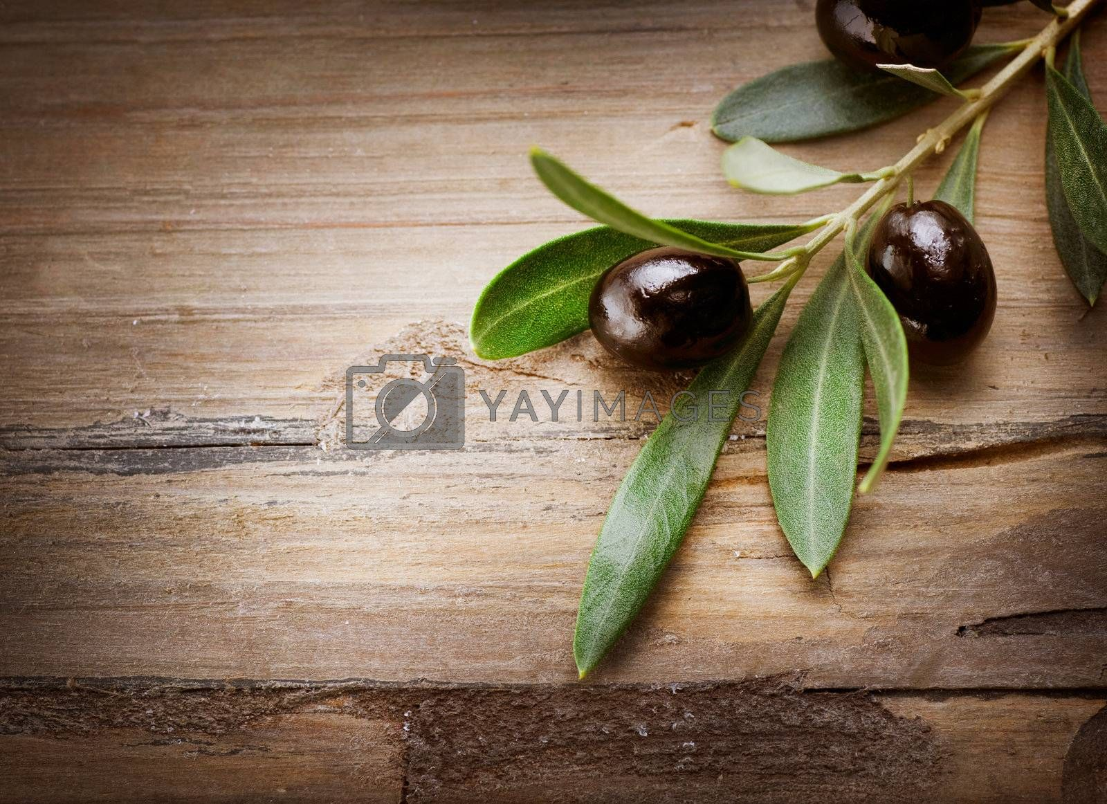 Olives over Wood Background by Subbotina Anna