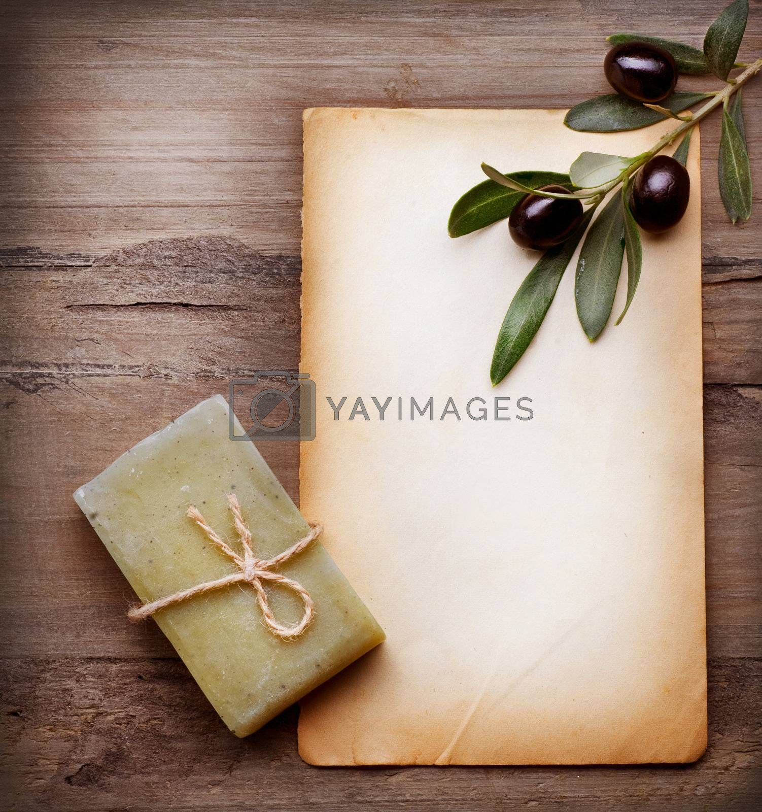 Handmade Olive Soap and Blank Paper with Olive Branch over Woode by Subbotina Anna