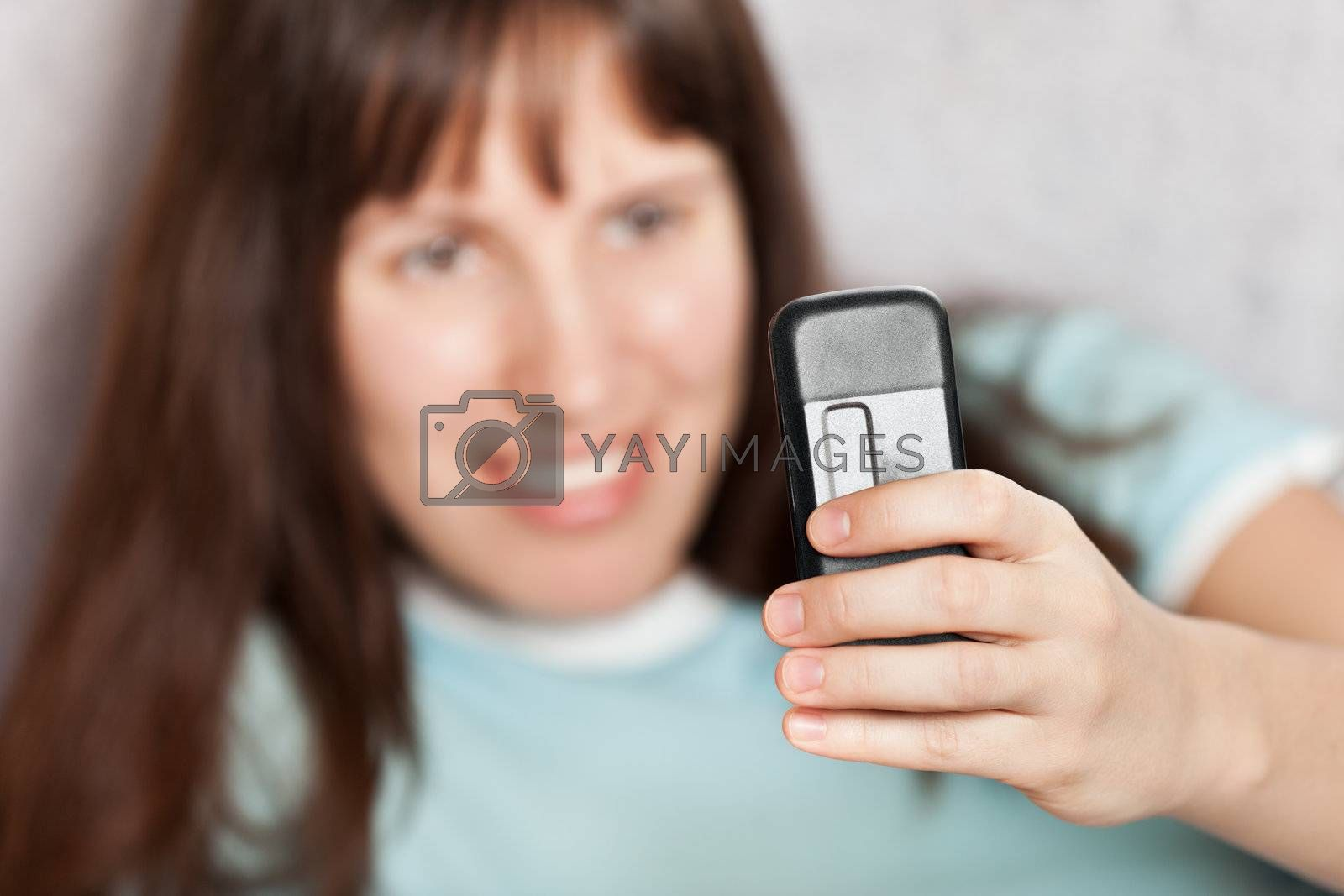 Smiling woman hand holding mobile communication phone