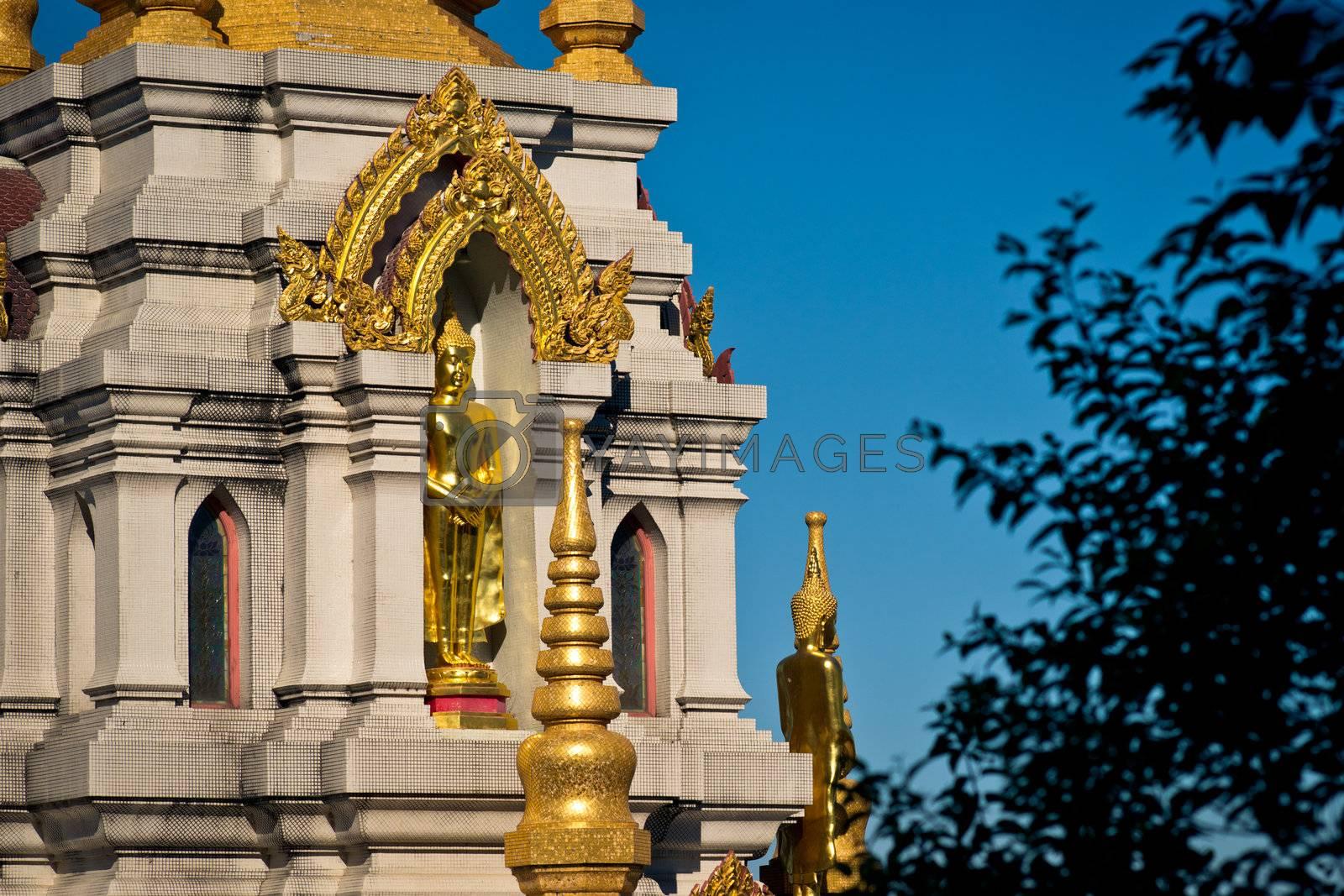 Golden statue of Buddha in buddhist chedi