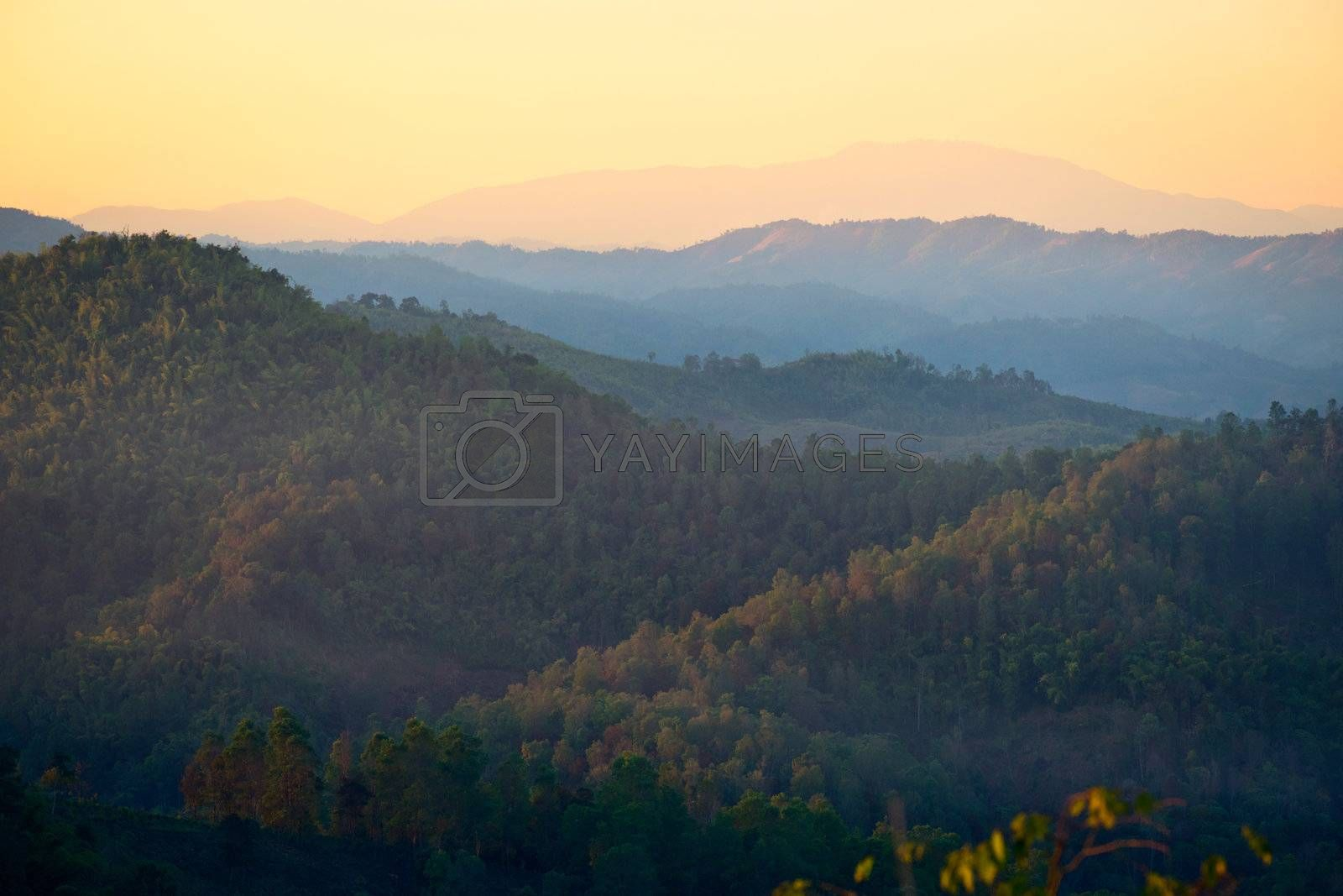 Mist in the mountains at sunset in northern Thailand