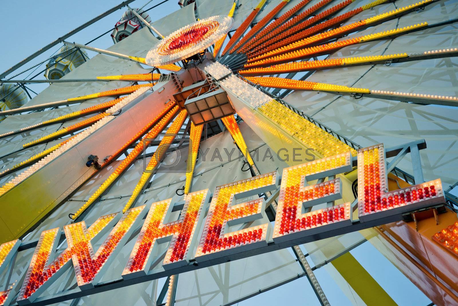 """Ferris wheel with glowing letters """"WHEEL"""" on it"""