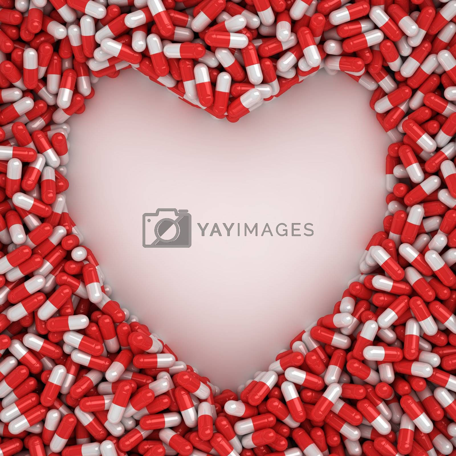 Symbol of heart made from red capsules on the white background