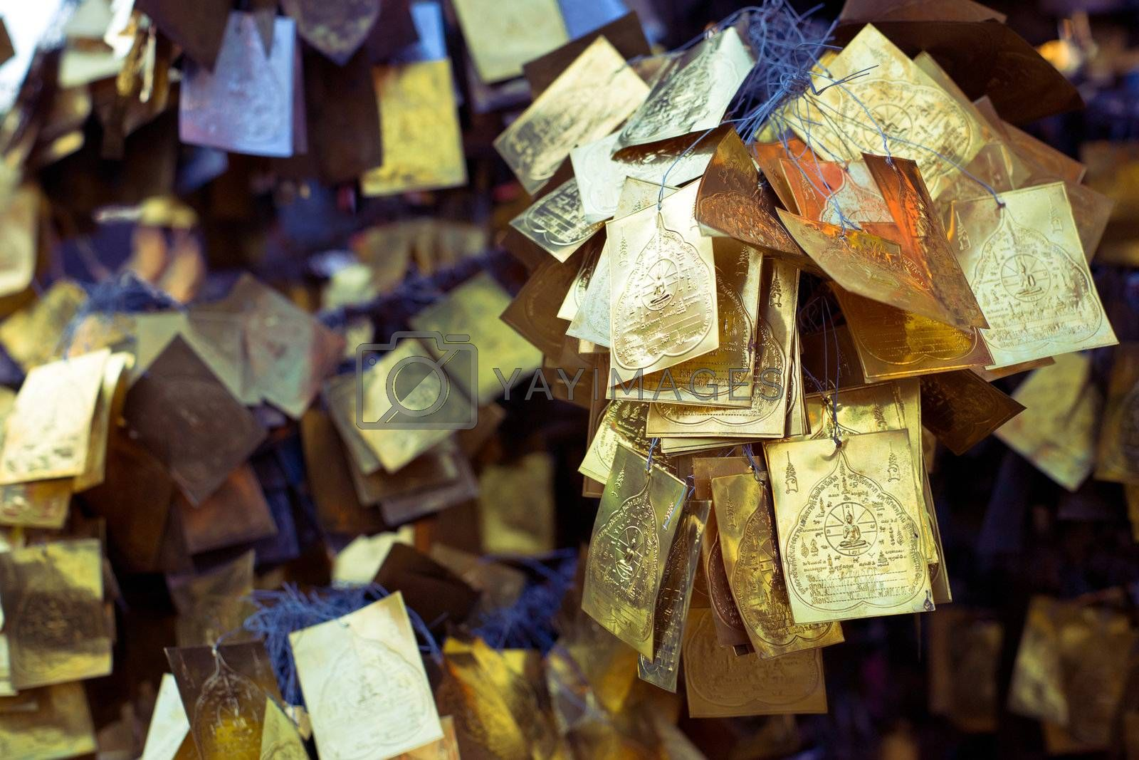 Religious golden cards hanging in the asian temple