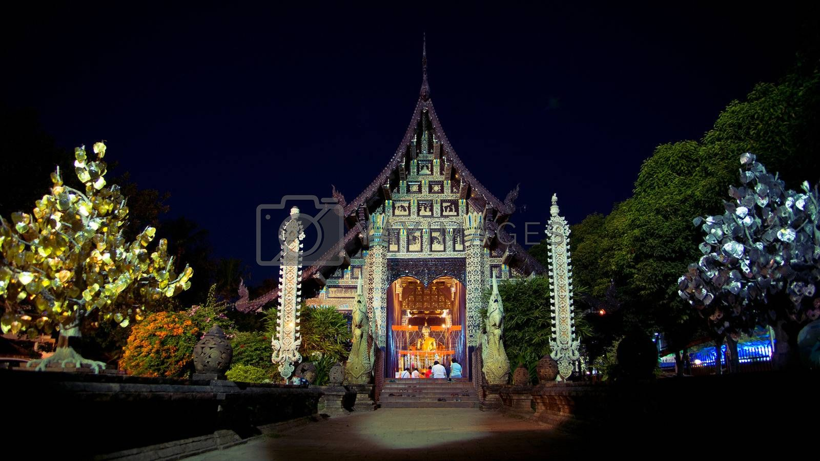 Night prayer at Lok Molee temple in Chiangmai, Thailand