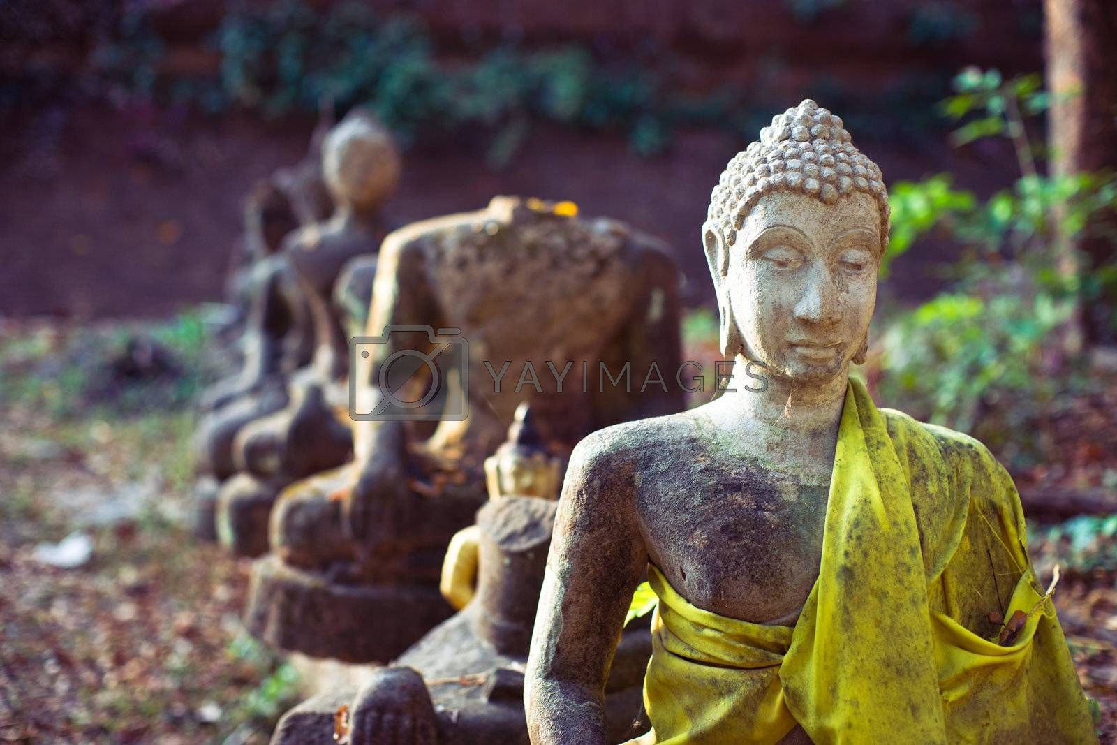 Old ruined buddhist statues in the ancient temple in Chiangmai, Thailand