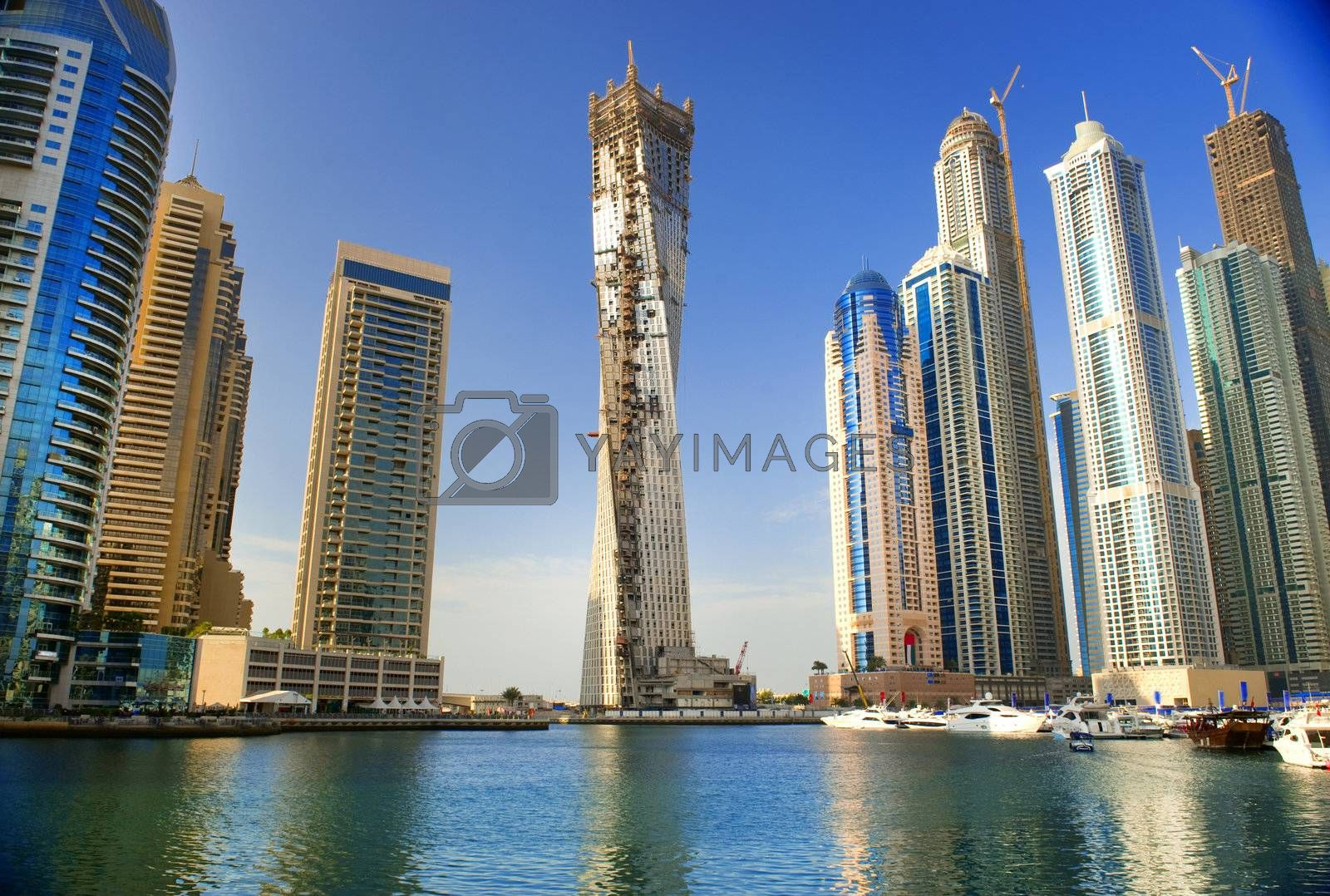 DUBAI, UAE - NOVEMBER 29: View at modern skyscrapers in Dubai Marina on November 29, 2011 in Dubai, UAE. Dubai Marina is a canal city, carved along 3 km stretch of Persian Gulf shoreline.