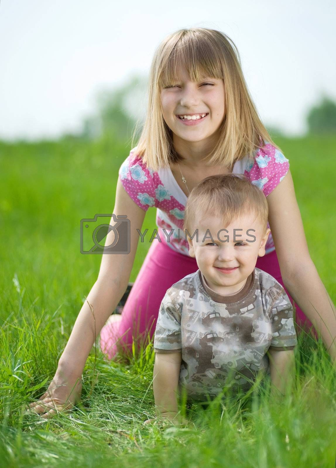 Happy Kids Having Fun Outdoor by Subbotina Anna