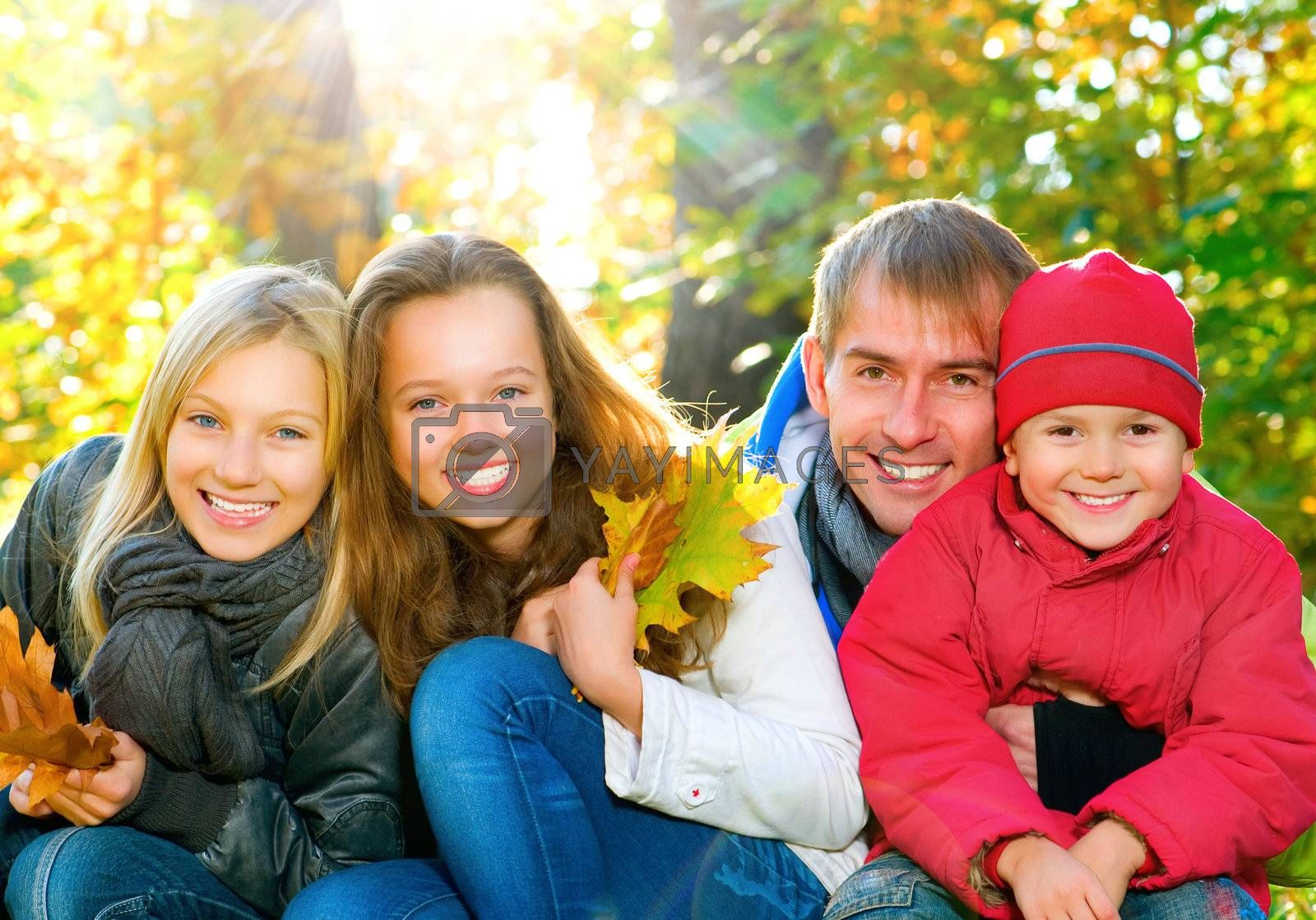 Happy Big Family With Kids Walking in Autumn Park. by Subbotina Anna