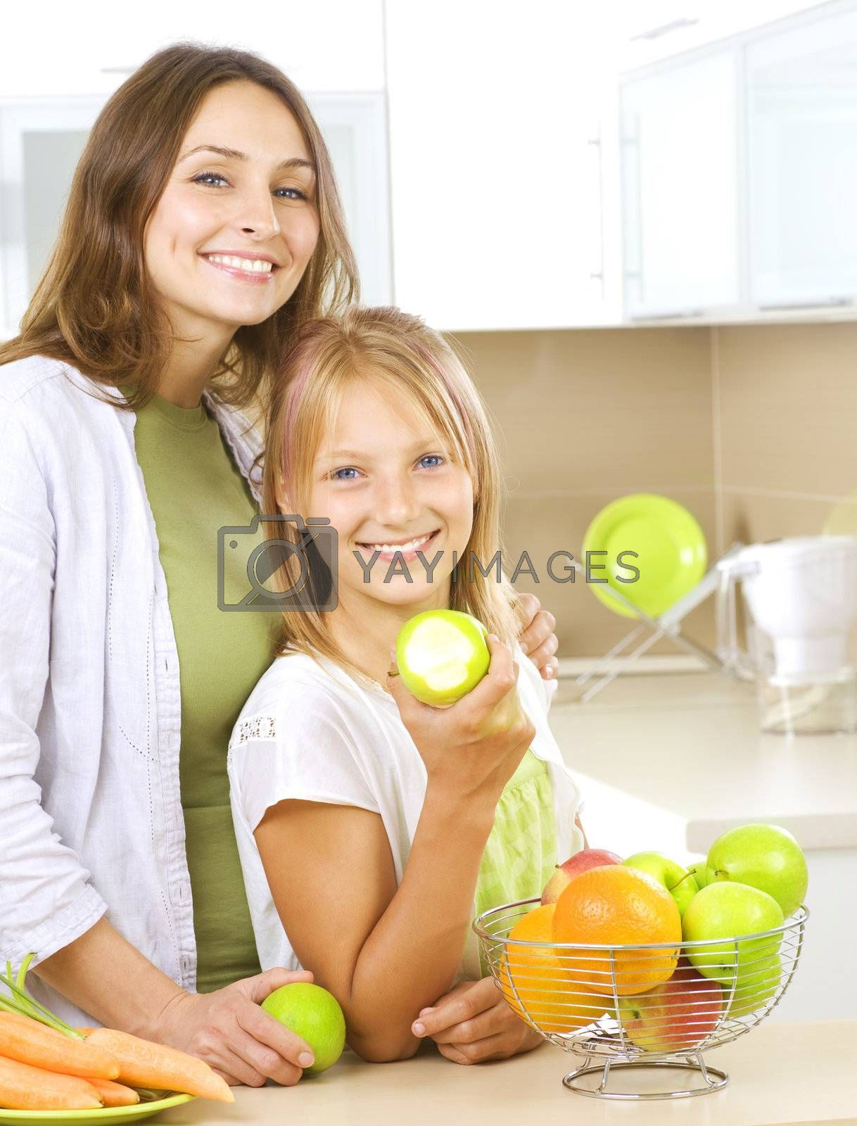 Happy Mother with Daughter eating Healthy food. Diet by Subbotina Anna
