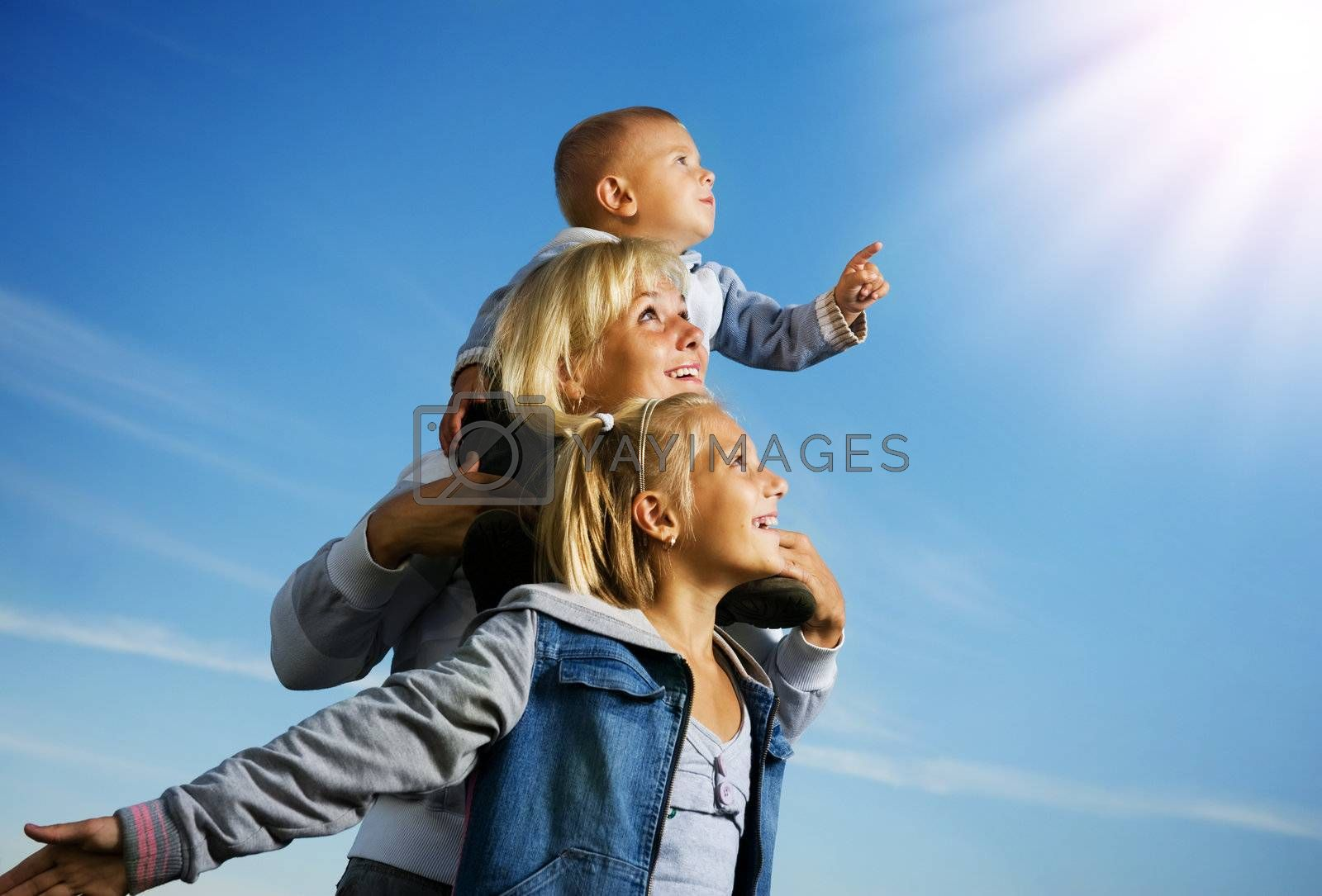 Healthy Family Outdoor. Happy Mother With Kids Over Blue Sky by Subbotina Anna