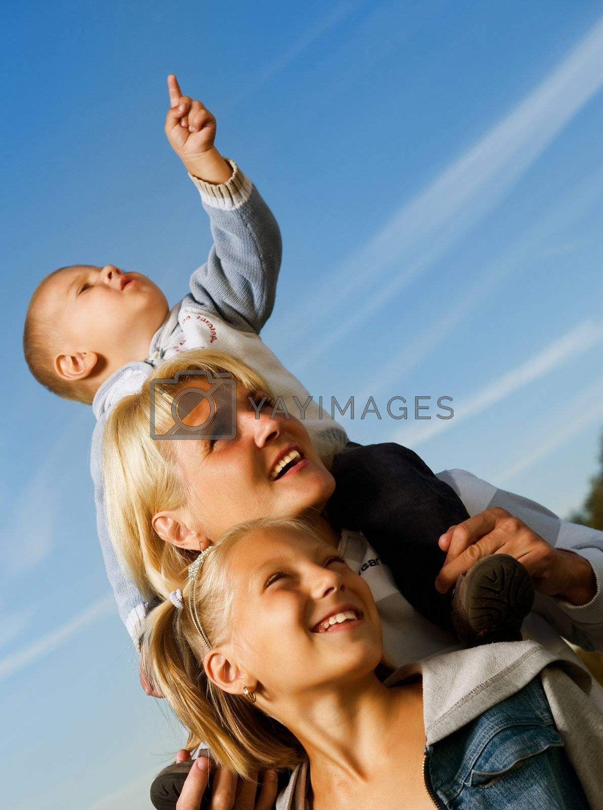 Healthy Family Outdoor. Happy Mother With Kids Over Blue Sky by SubbotinaA