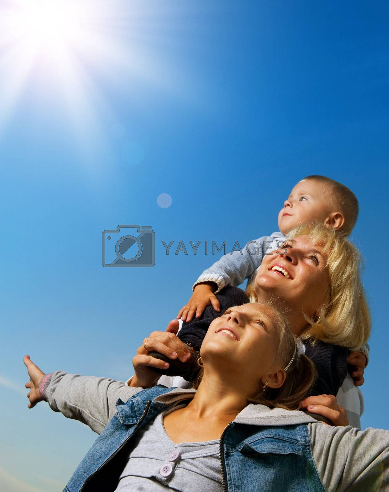 Healthy Family Outdoor. Happy Mother With Kids Over Blue Sky