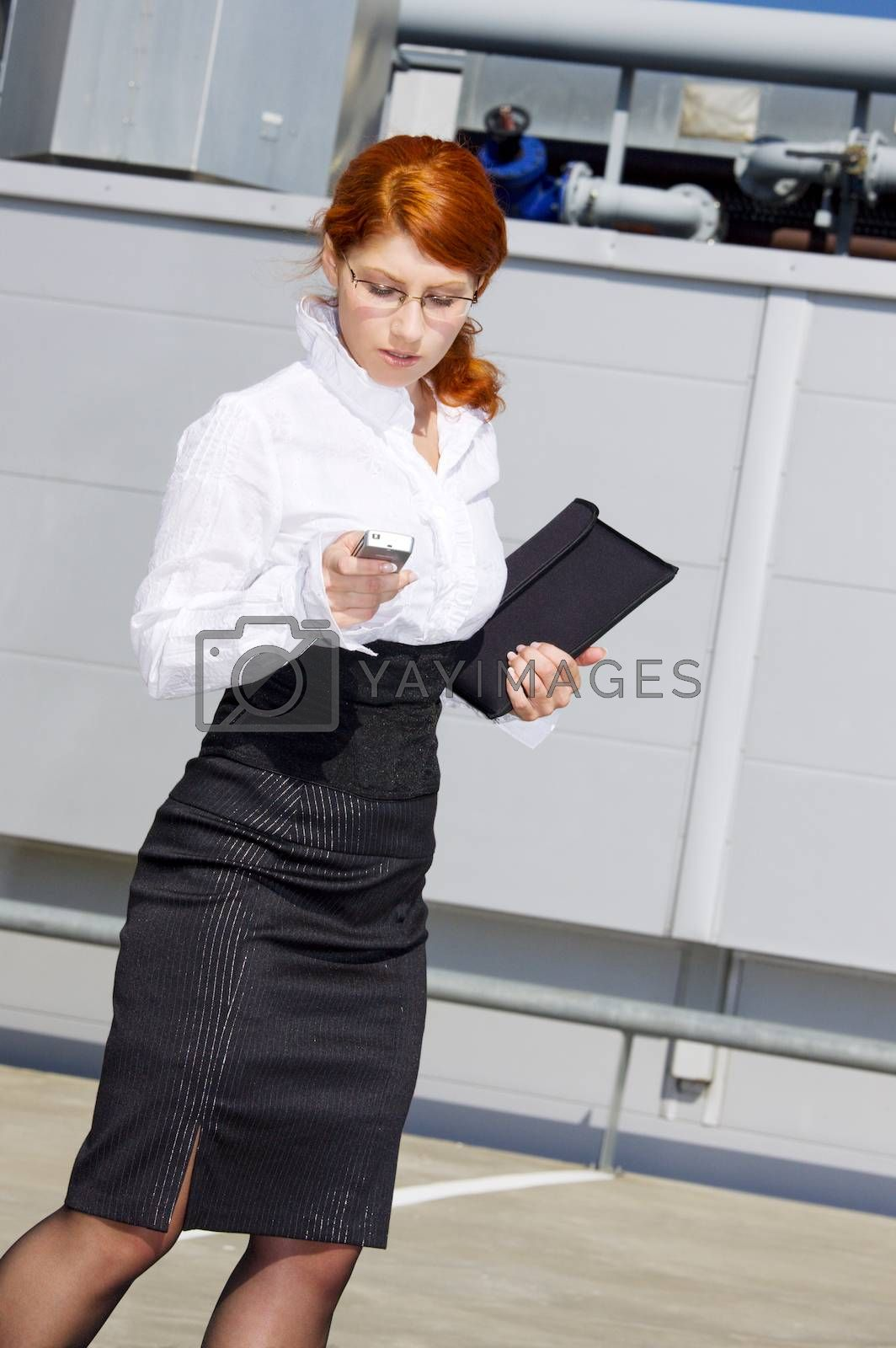bright picture of businesswoman with folder and phone