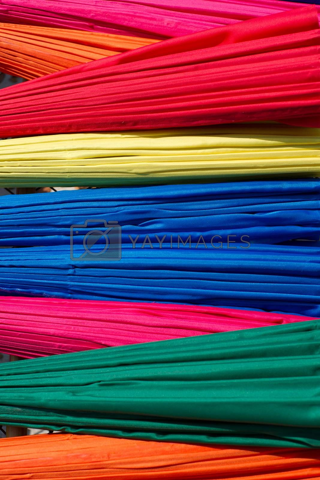 Background from closed multicolored umbrellas made in Bo Sang village, Chiang Mai province, Thailand
