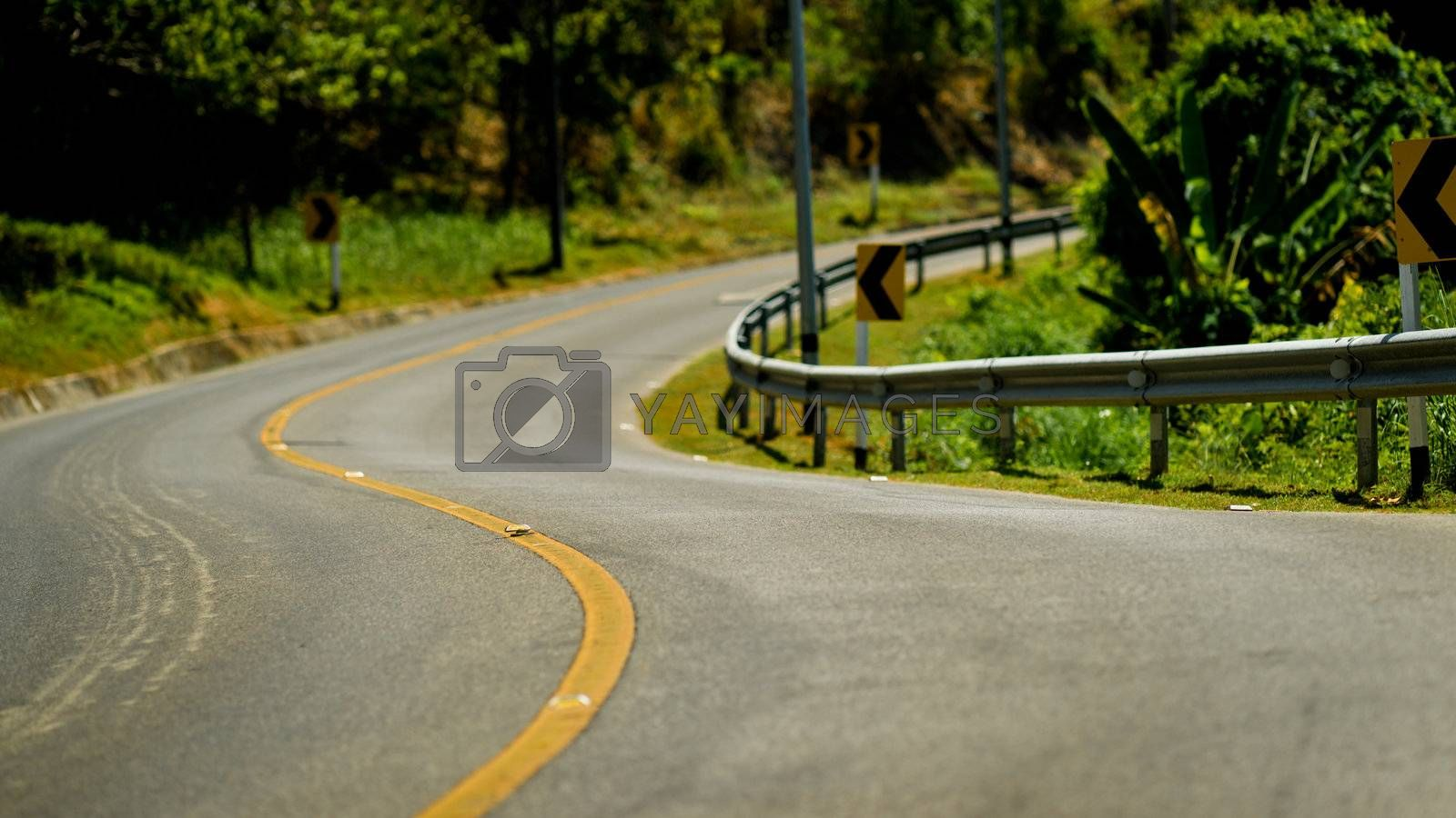 Yellow dividing line on the turning road