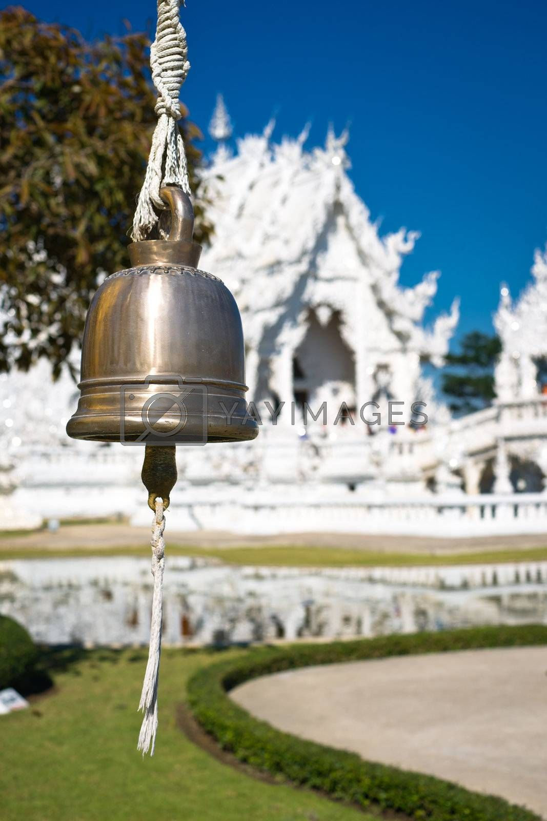 Bell in white temple Wat Rong Khun. Wat Rong Khun is a contemporary unconventional Buddhist temple in Chiang Rai, Chiangmai province, Thailand. It is designed in white color.