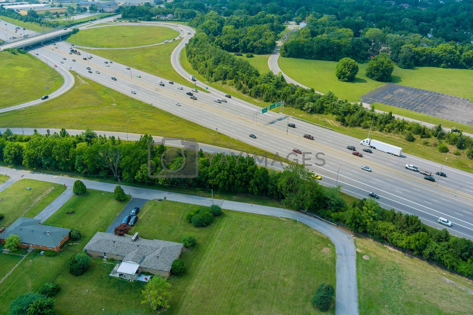 Royalty free image of Highway US interstate 70 through the Scioto Woods, Columbus, Ohio USA of aerial view by ungvar