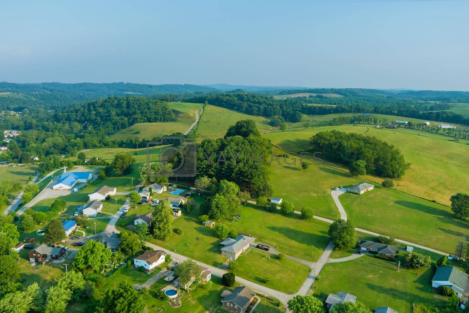 Royalty free image of An aerial establishing view of the small Bentleyville town villages on the hills of Pennsylvania USA by ungvar