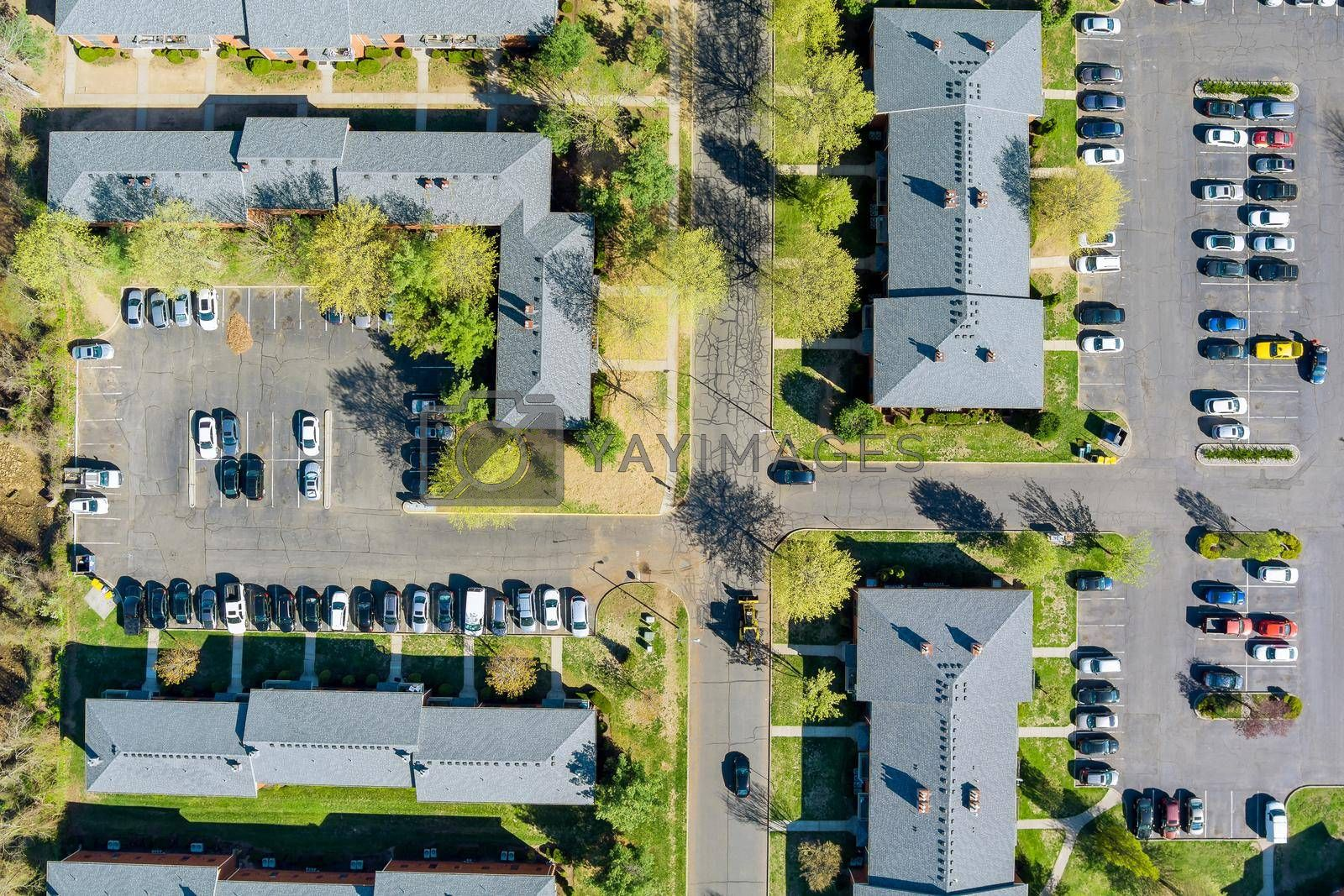 Royalty free image of Exterior view residential apartment complex in street and home by ungvar