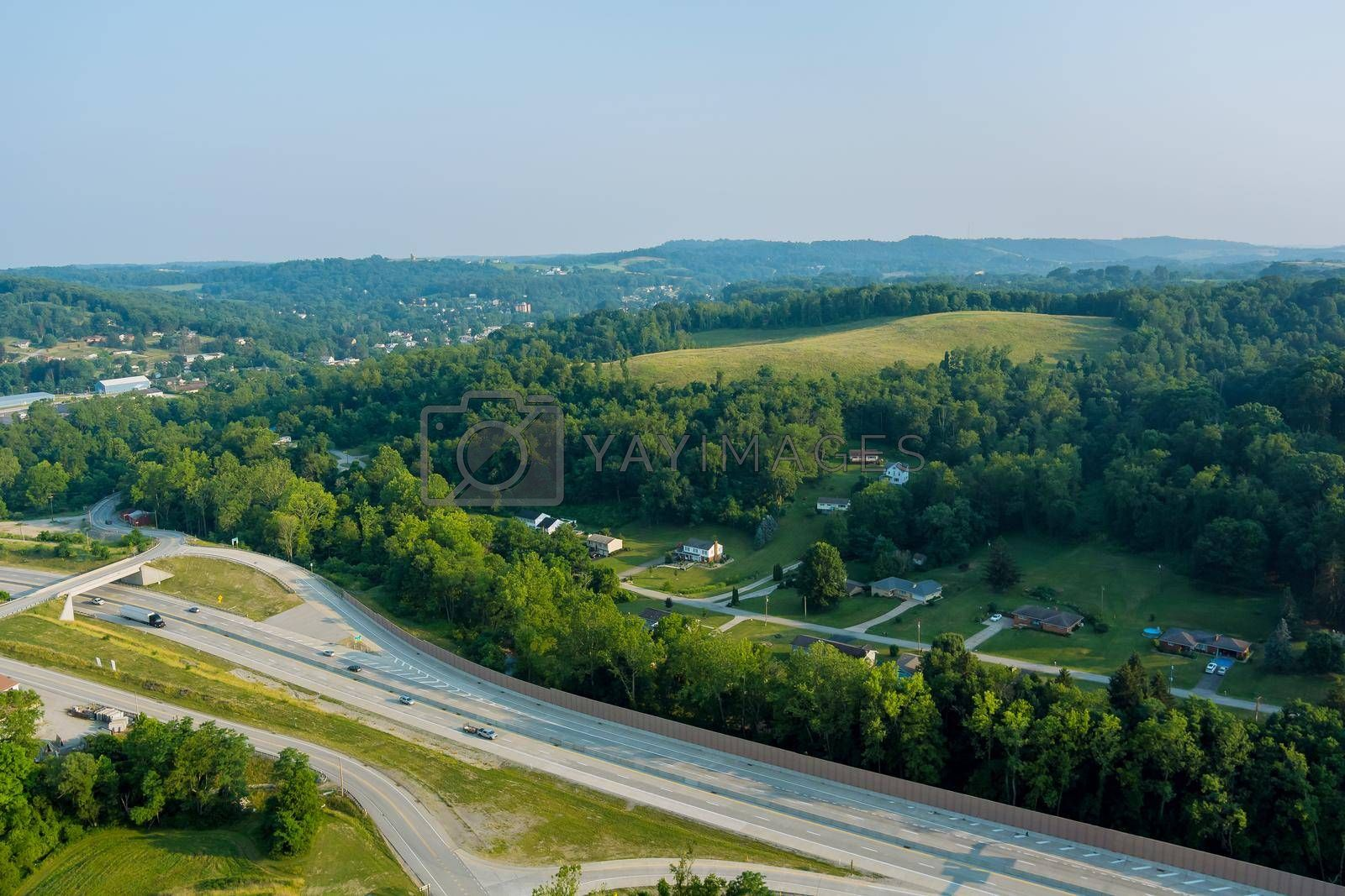 Royalty free image of Panoramic view of Dwight D. Eisenhower highway 70 road near small Bentleyville town hills the farm meadow in Pennsylvania, US by ungvar