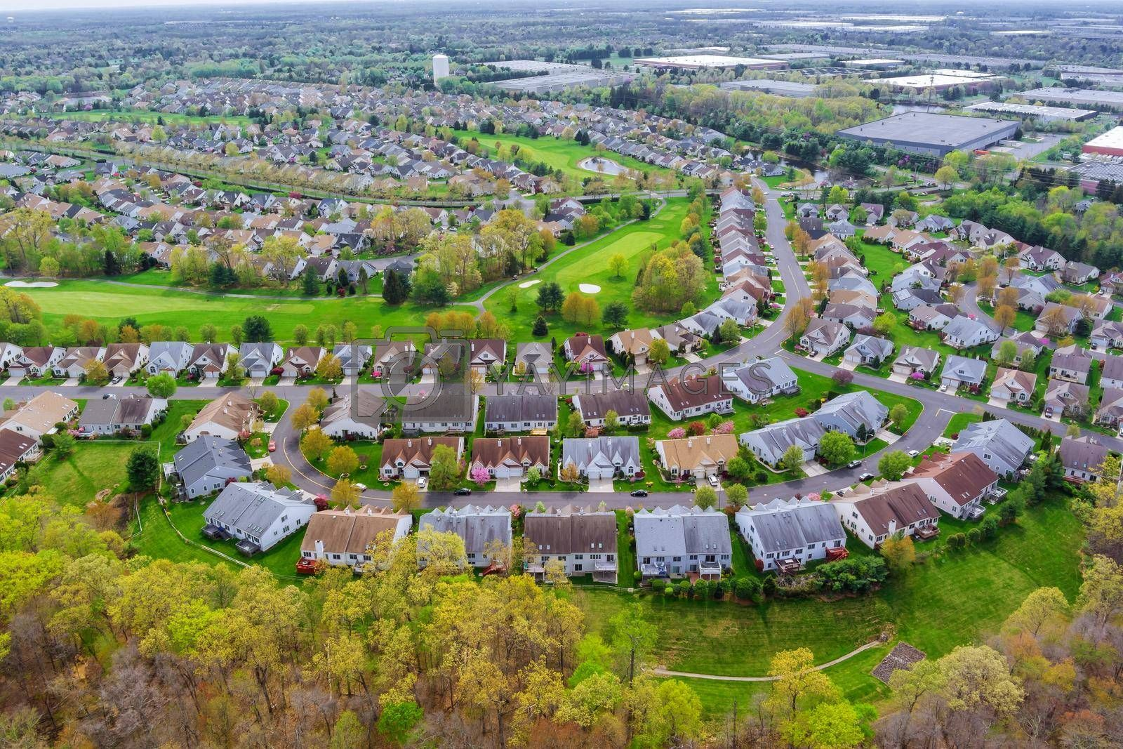 Royalty free image of Panorama view of american small town residential houses neighborhood suburban complex by ungvar
