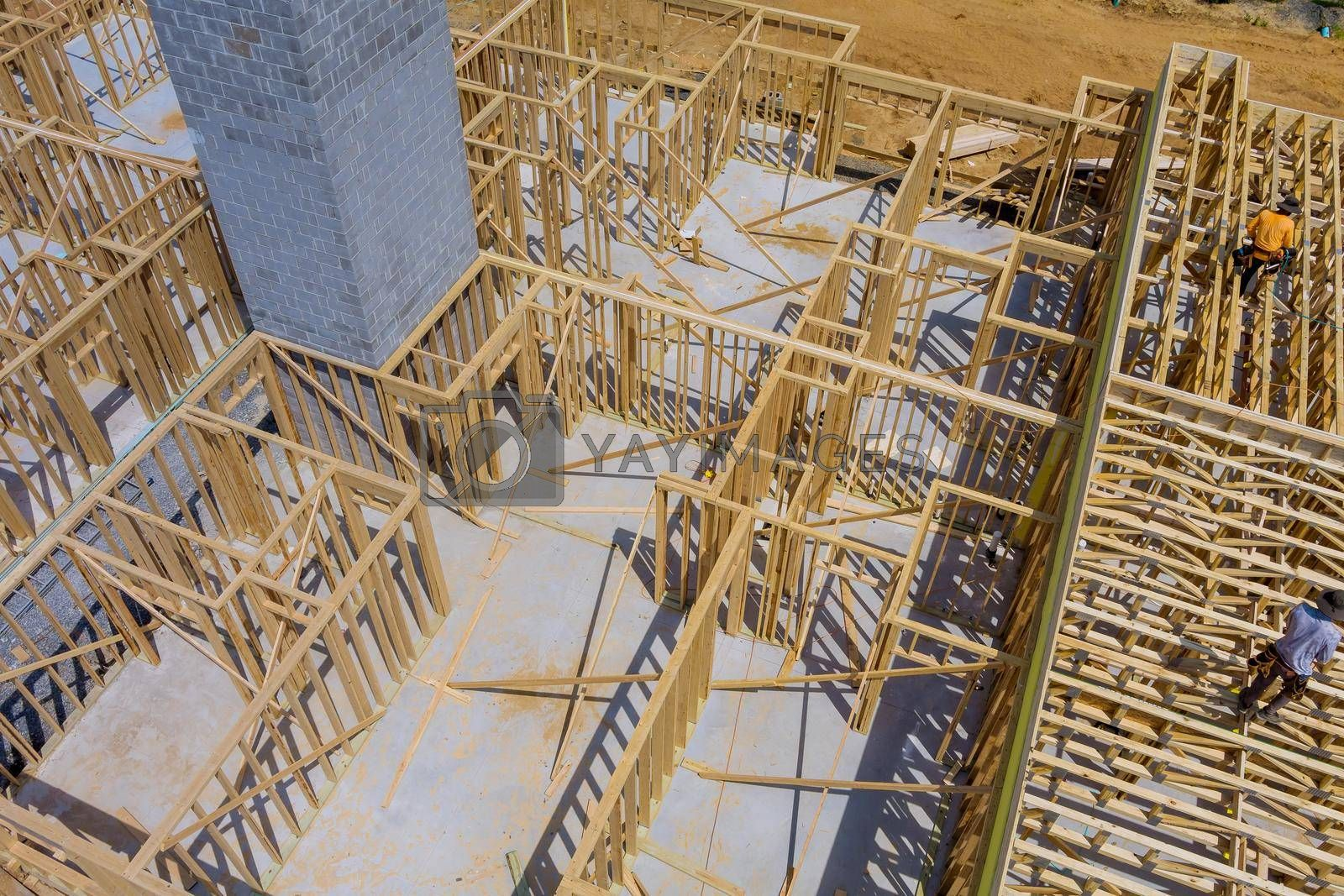 Royalty free image of New home construction framing of a house under construction by ungvar