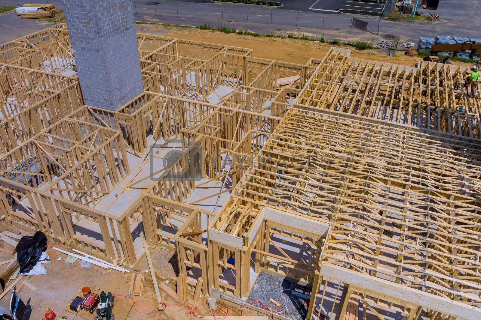 Royalty free image of Wood building frame structure on a new development by ungvar