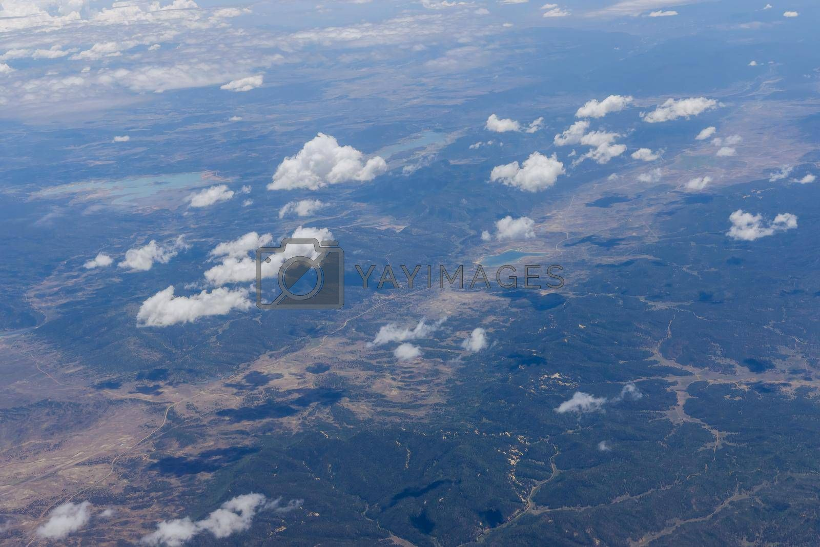 Royalty free image of Overview of fluffy clouds in mountains from an airplane, Arizona by ungvar