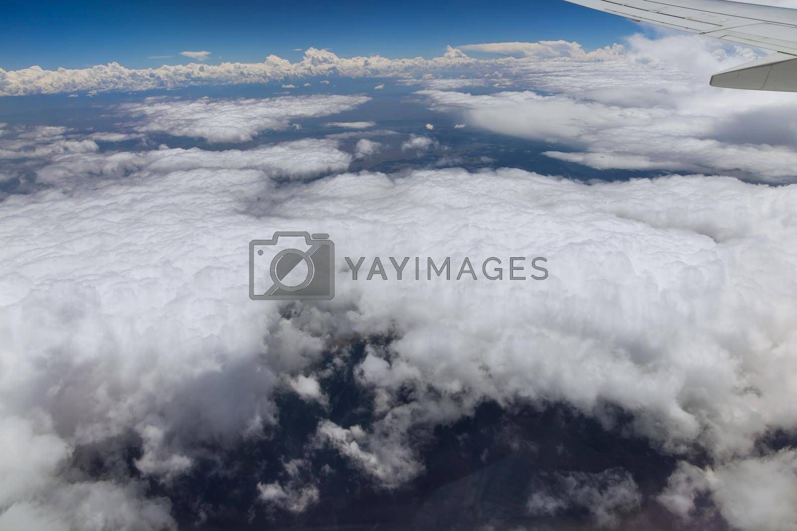 Royalty free image of Wing aircraft in altitude during flying above the clouds by ungvar