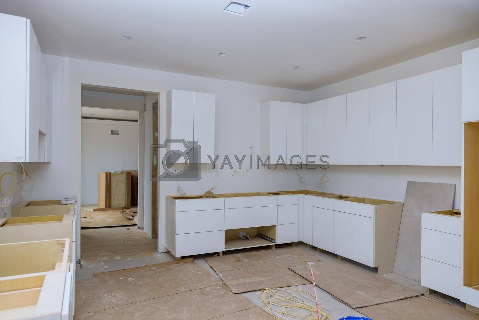 Royalty free image of White of kitchen wooden cabinets with contemporary by ungvar