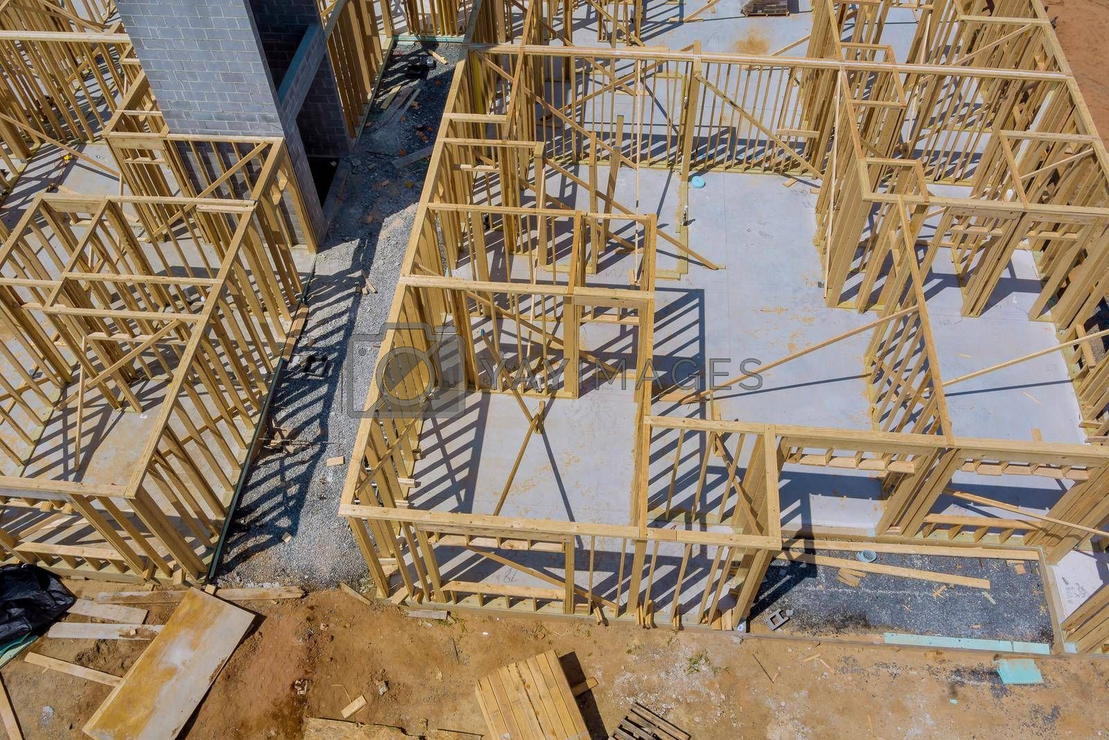 Royalty free image of Framing beam of new house under construction home framing by ungvar