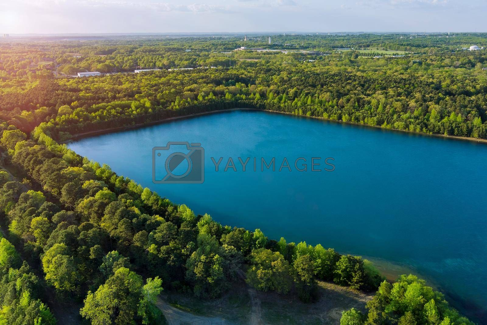 Royalty free image of Aerial panorama view on the green forest between turquoise color lake by ungvar