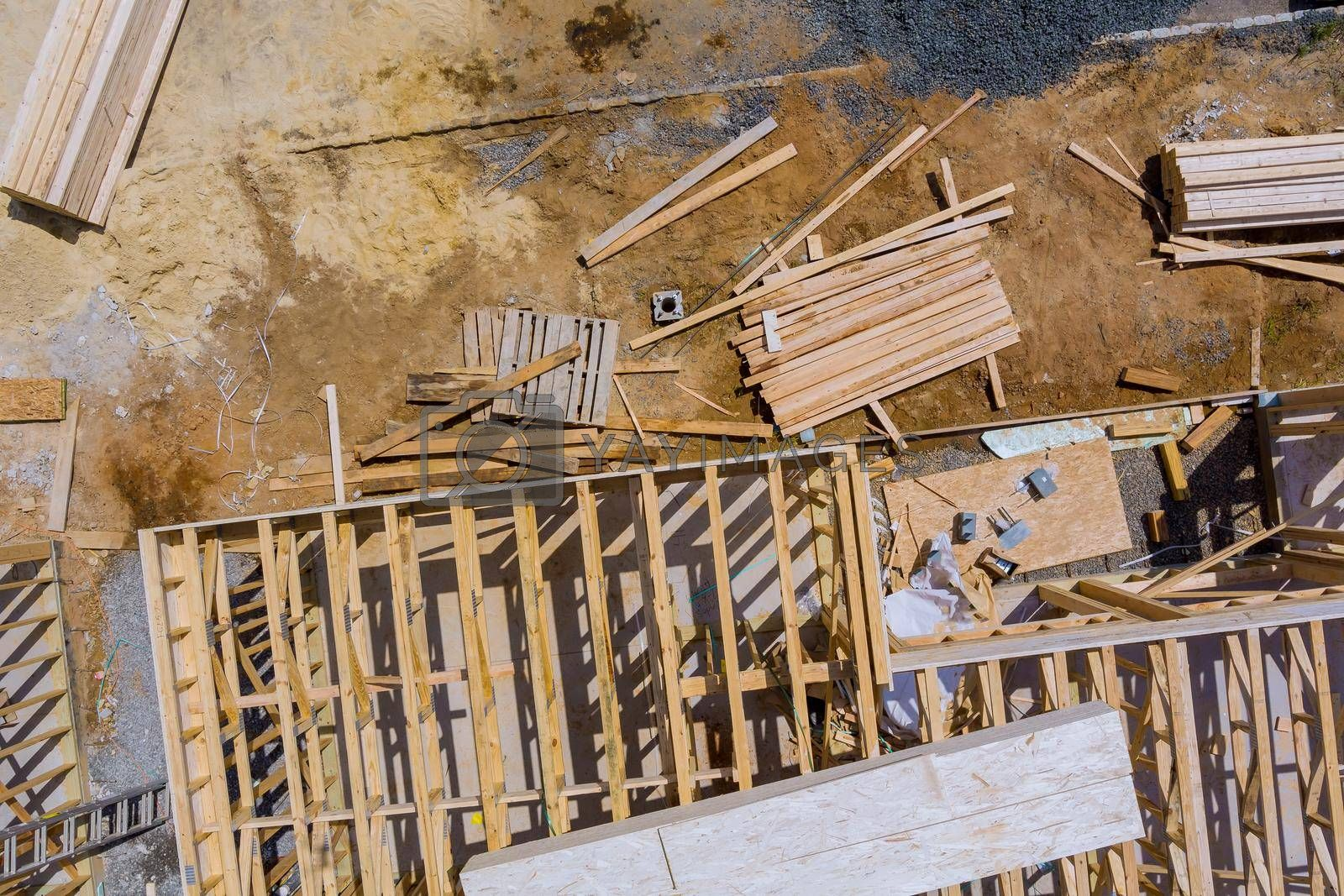 Royalty free image of Stacked wooden building materials a stack of boards wood frame and beam construction by ungvar