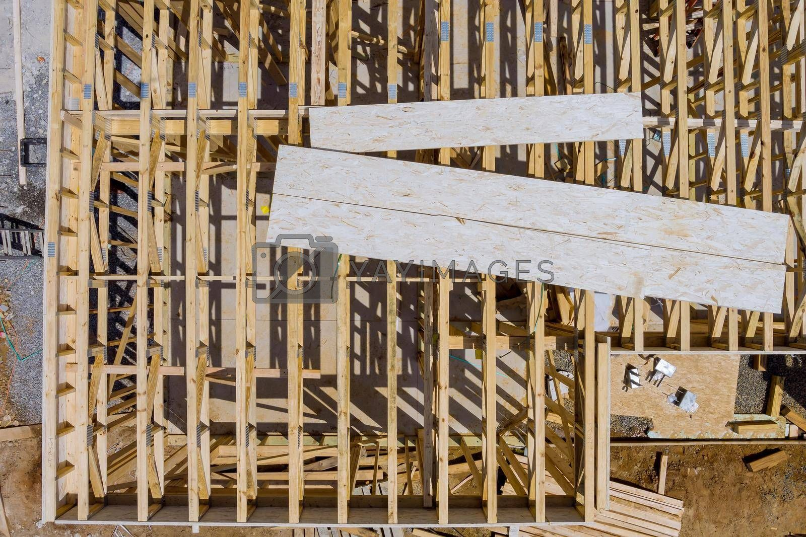 Royalty free image of Truss, joist, beam new house under construction exterior framing timber framing by ungvar