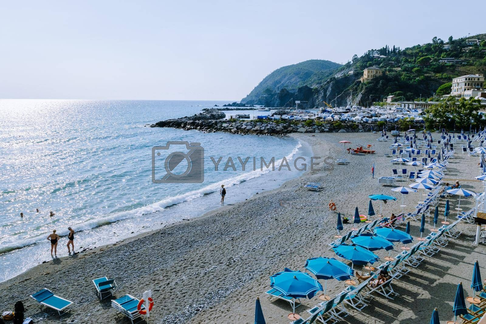 Levanto Cinque Terre colorful village Italy, colorful beach with an umbrella during the summer holiday. Levanto Cinque Terre Italy September 2018